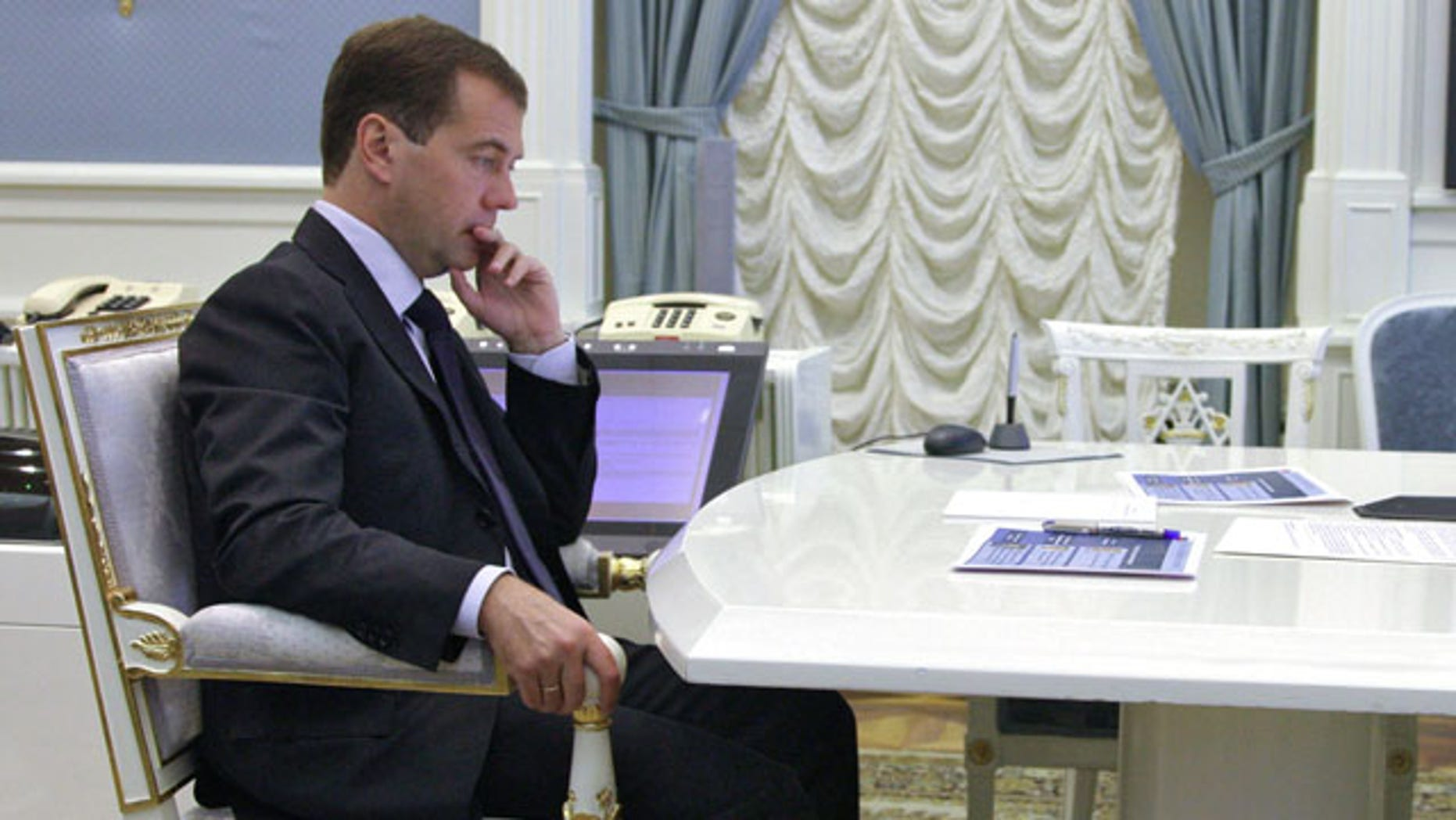 Sept. 9: Russian President Dmitry Medvedev takes part in a conference call in the Kremlin in Moscow.