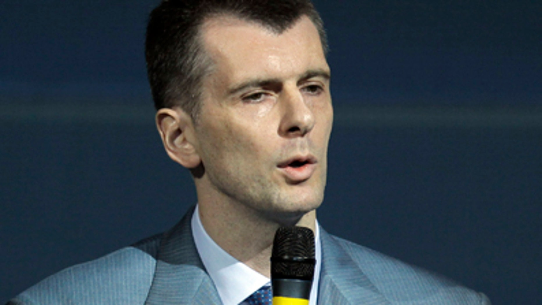 June 25: Russian tycoon Mikhail Prokhorov speaks at a meeting of the Right Cause party in Moscow. Russian tycoon and New Jersey Nets basketball team owner Mikhail Prokhorov was confirmed Saturday as the new head of a Kremlin-friendly political party. The 46-year-old billionaire was all but unanimously elected head of the Right Cause party by its members on Saturday.