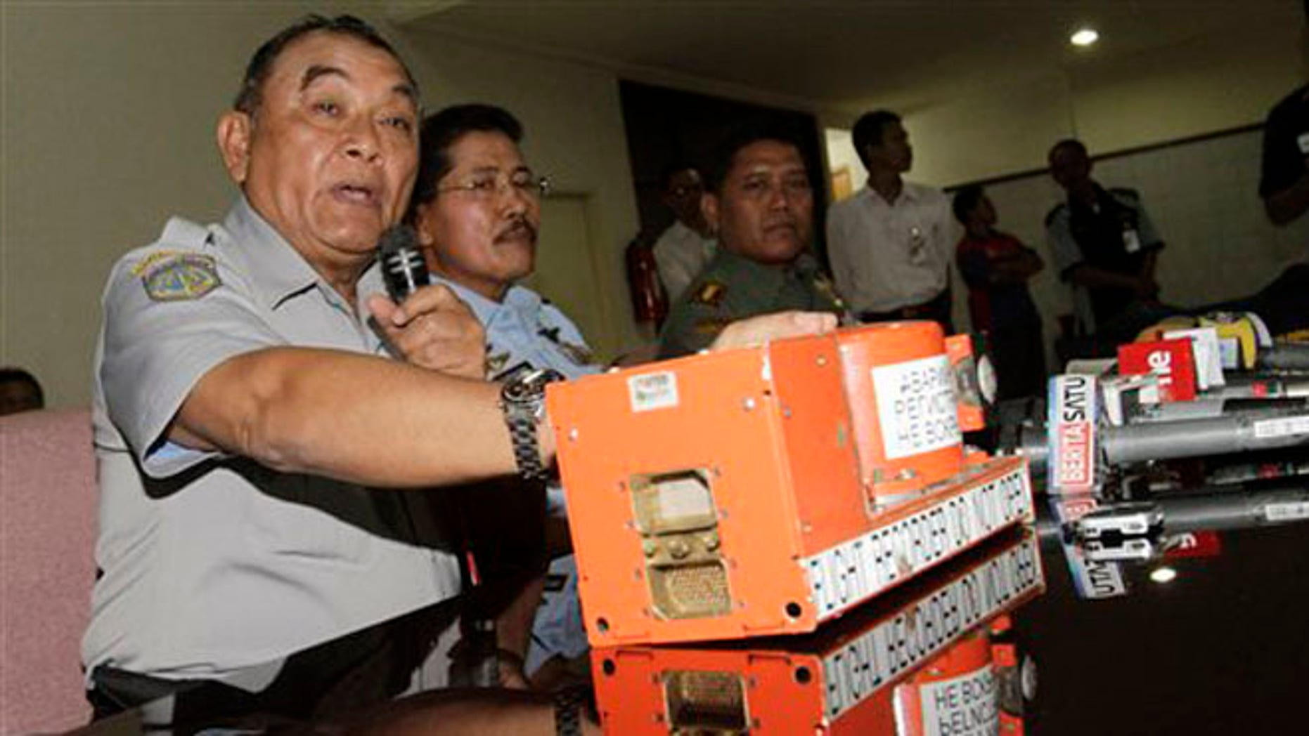 May 31, 2012: Indonesian National Transportation Safety Board chief Tatang Kurniadi with the flight data recorder of the crashed Sukhoi Superjet 100 speaks during a press conference in Jakarta, Indonesia.