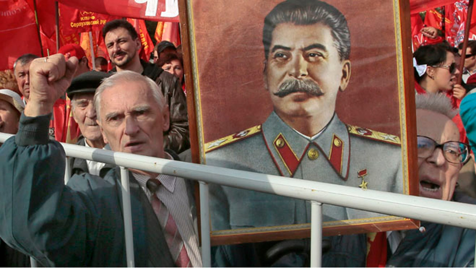 Sept. 22, 2012: Russian Communist Party supporters hold a portrait of former Soviet dictator Josef Stalin at a gathering in Moscow to protest increasing prices for communal services.
