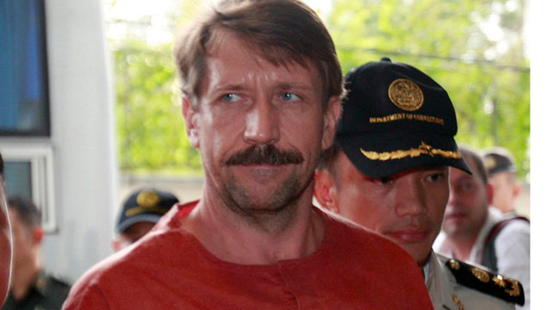 August 20: Suspected Russian arms dealer Viktor Bout, is escorted by prison officials as he arrives at the criminal court in Bangkok, Thailand.(AP)