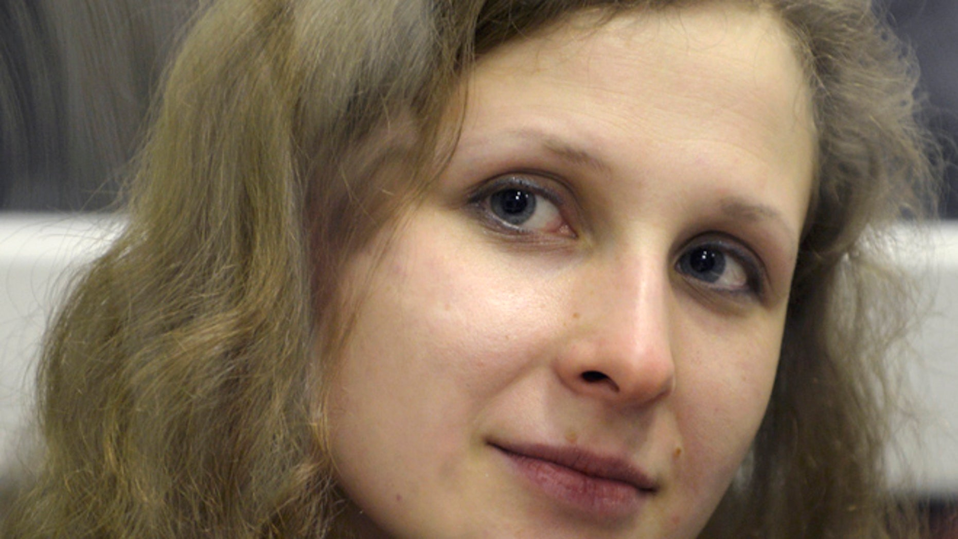 In this Jan. 16, 2013 file photo, jailed feminist punk band Pussy Riot member Maria Alekhina is in a defendant's cage in a court room in the town of Berezniki, north-east of Moscow, Russia. A Russian activist says that Alekhina has ended her 11-day hunger strike June 1, 2013,  after prison authorities met her demands.