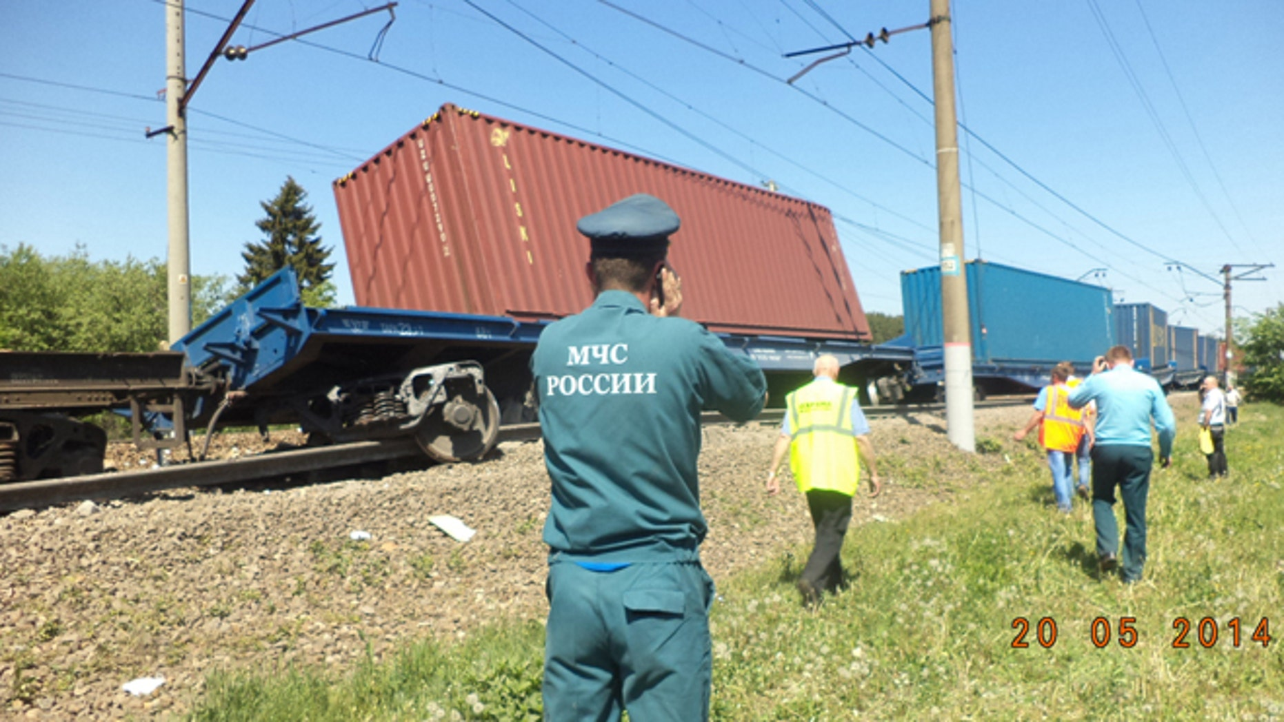 May 20, 2014: A ministry employee uses a mobile phone at the site of train collision near the city of Naro-Fominsk outside Moscow.  (AP/ Ministry for Emergency Situations Press Service)