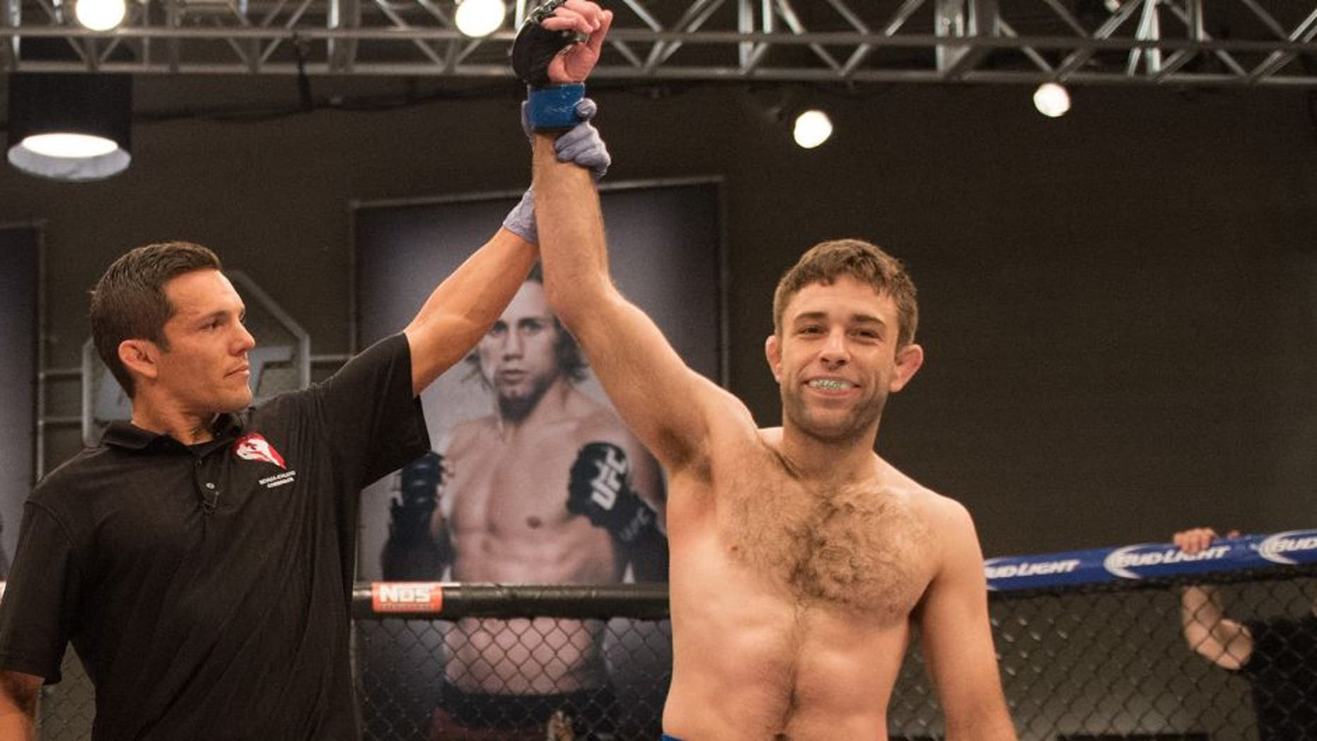 LAS VEGAS, NV - JULY 24: (R-L) Ryan Hall celebrates his submission victory over Frantz Slioa during the filming of The Ultimate Fighter: Team McGregor vs Team Faber at the UFC TUF Gym on July 24, 2015 in Las Vegas, Nevada. (Photo by Brandon Magnus/Zuffa LLC/Zuffa LLC via Getty Images)