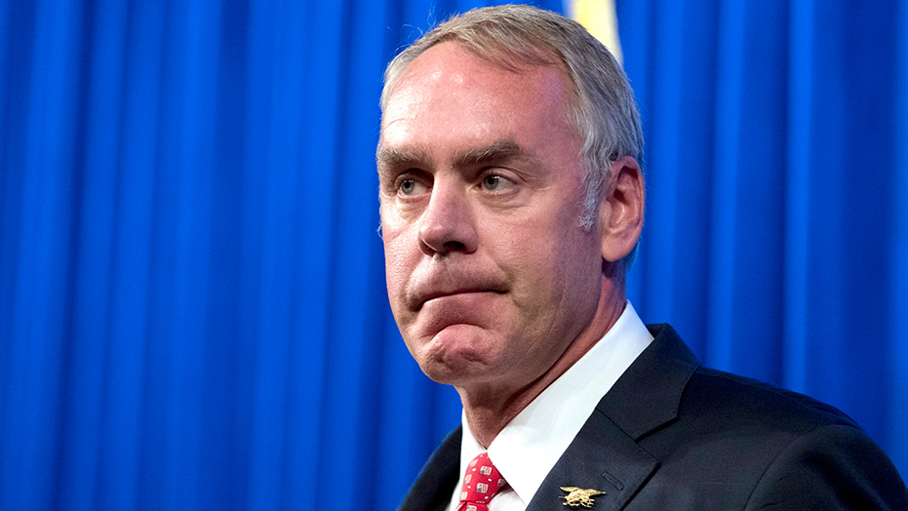FILE - In this Sept. 29, 2017, file photo, Interior Secretary Ryan Zinke speaks about the Trump Administration's energy policy at the Heritage Foundation in Washington.