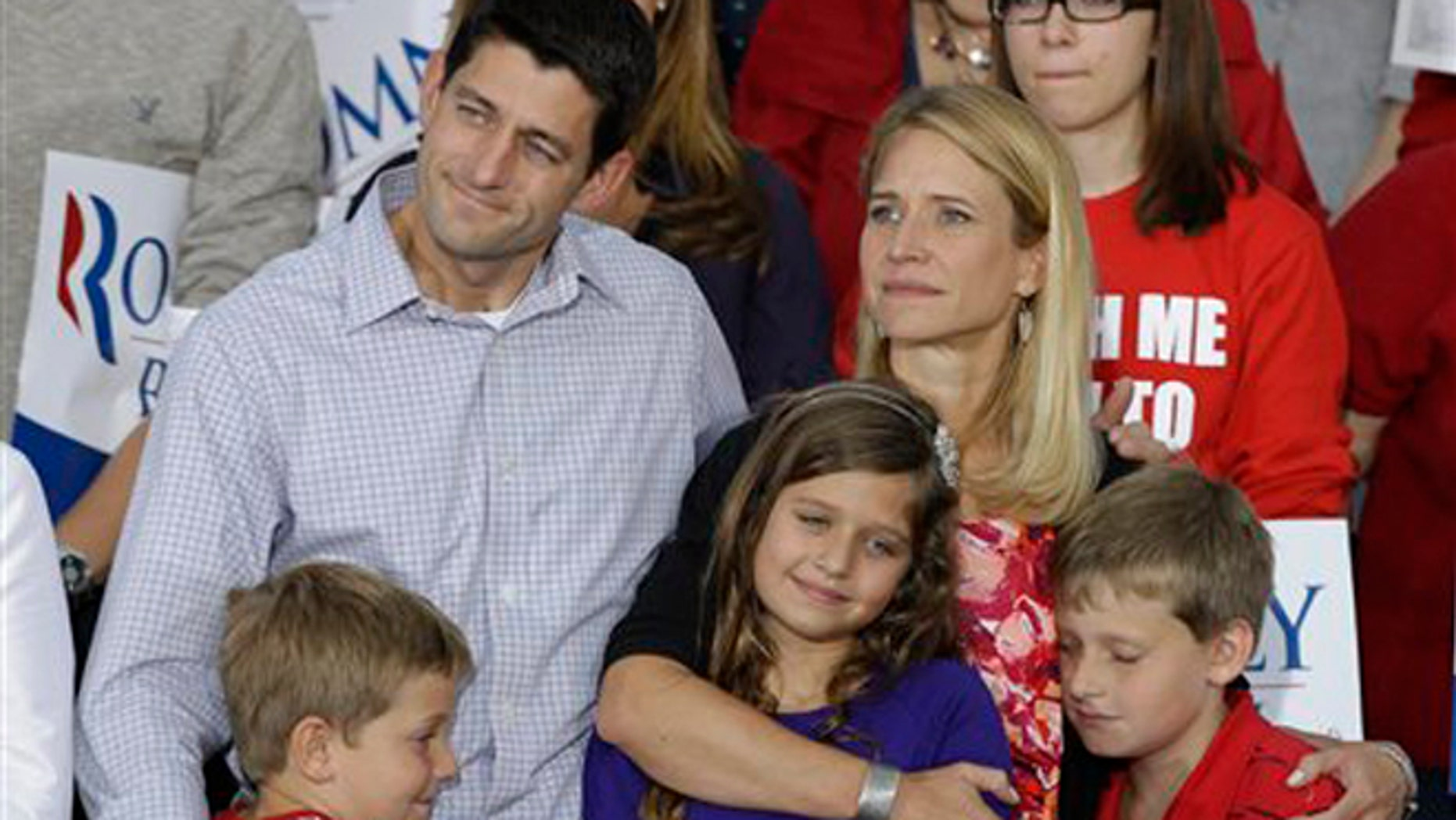 Sunday, August, 12, 2012: GOP Vice presidential candidate Rep. Paul Ryan, R-Wis, with wife Janna, daughter Liza and sons Charles, and Sam, right, during a rally  in Waukesha, Wis.