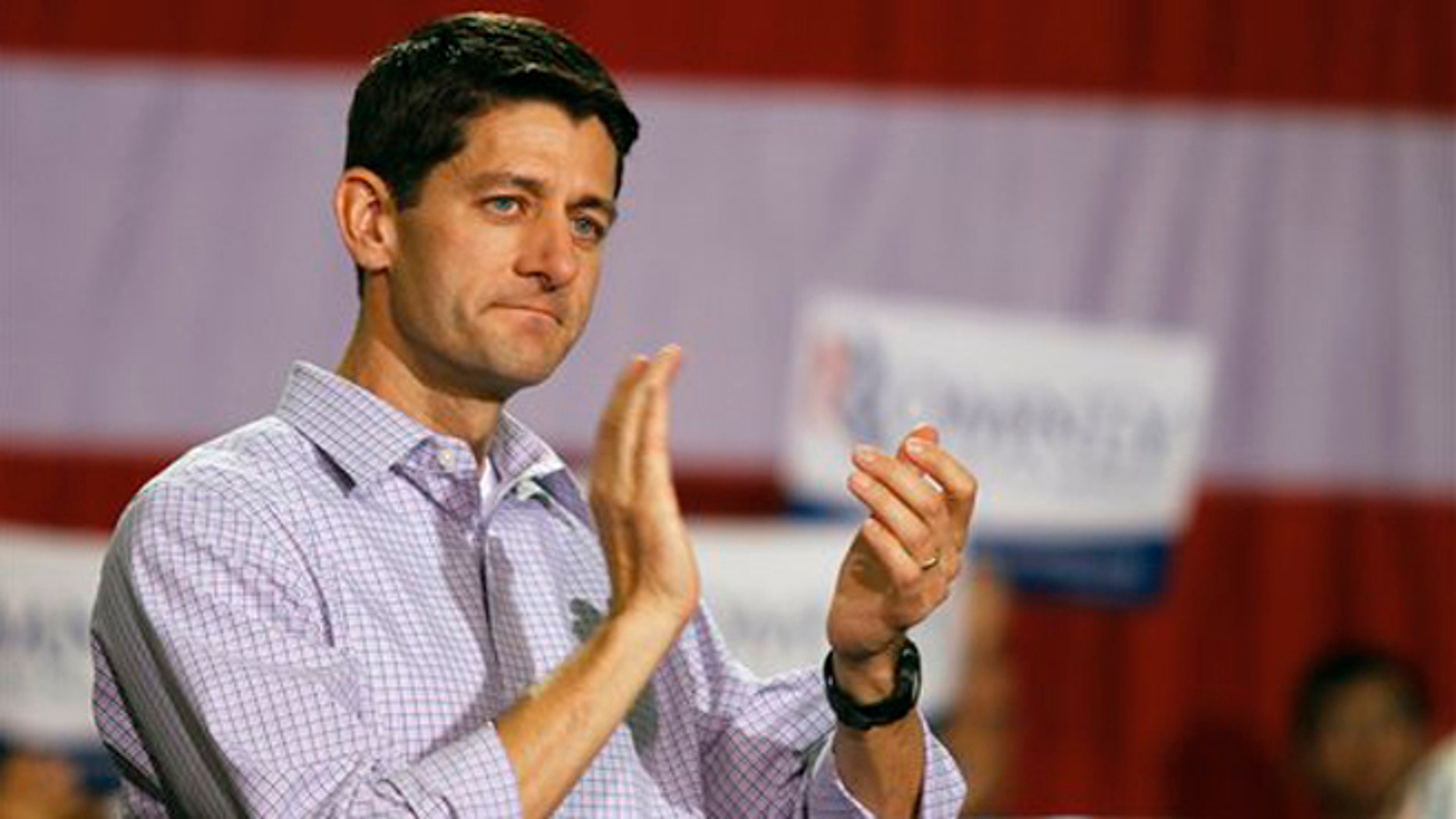 CORRECTS DATELINE - Republican presidential candidate Mitt Romney's vice presidential running mate Rep. Paul Ryan, of Wisconsin, appears during a campaign rally at the NASCAR Technical Institute in Mooresville, N.C., Sunday, Aug. 12, 2012. (AP Photo/Charlotte Observer, Adam Jennings)