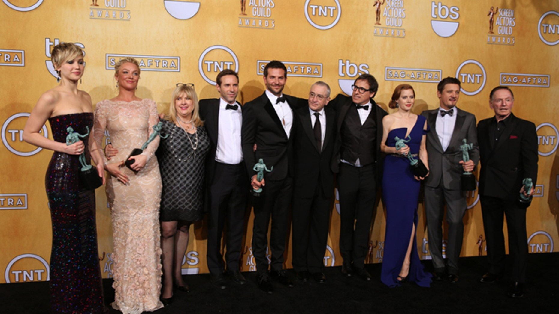 From left, Jennifer Lawrence, Elisabeth Rohm, Colleen Camp, Alessandro Nivola, Bradley Cooper, Robert De Niro, David O. Russell, Amy Adams, Jeremy Renner and Paul Herman pose in the press room with the award for outstanding performance by a cast in a motion picture for âAmerican Hustleâ at the 20th annual Screen Actors Guild Awards at the Shrine Auditorium on Saturday, Jan. 18, 2014, in Los Angeles. (Photo by Matt Sayles/Invision/AP)