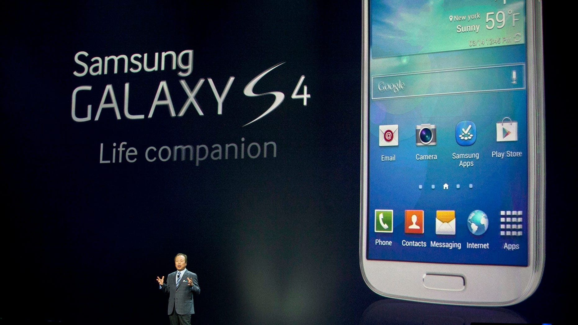 NEW YORK, NY - MARCH 14: JK Shin, President and Head of IT and mobile communication division of Samsung introduces the Samsung Galaxy S IV, March 14, 2013 in New York City.
