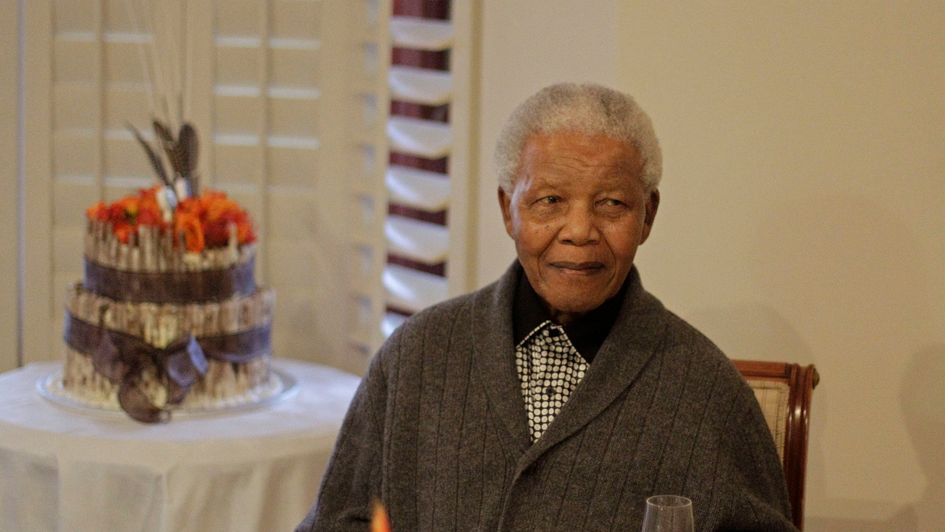 July 18, 2012 - FILE photo of former South African President Nelson Mandela as he celebrates his birthday with family in Qunu, South Africa.