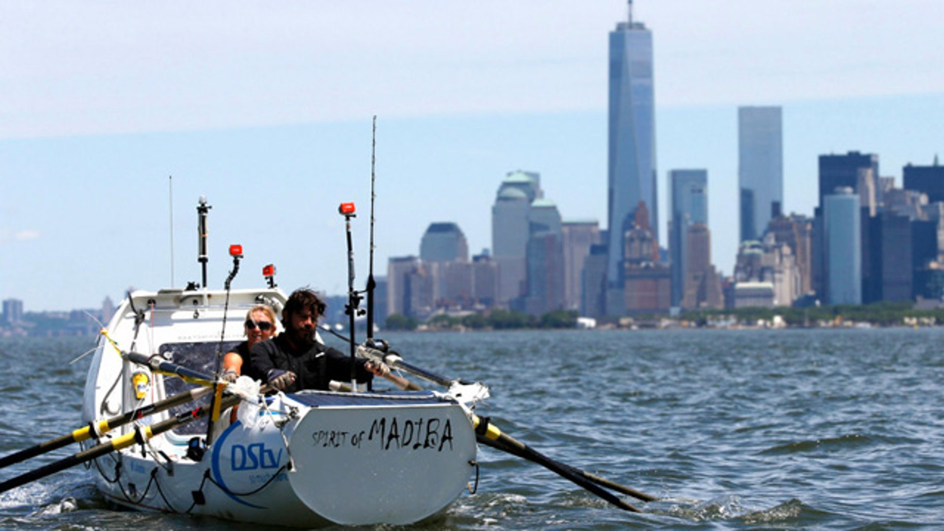 June 20, 2014: Riaan Manser and Vasti Geldenhuys row into New York Harbor. (Reuters)