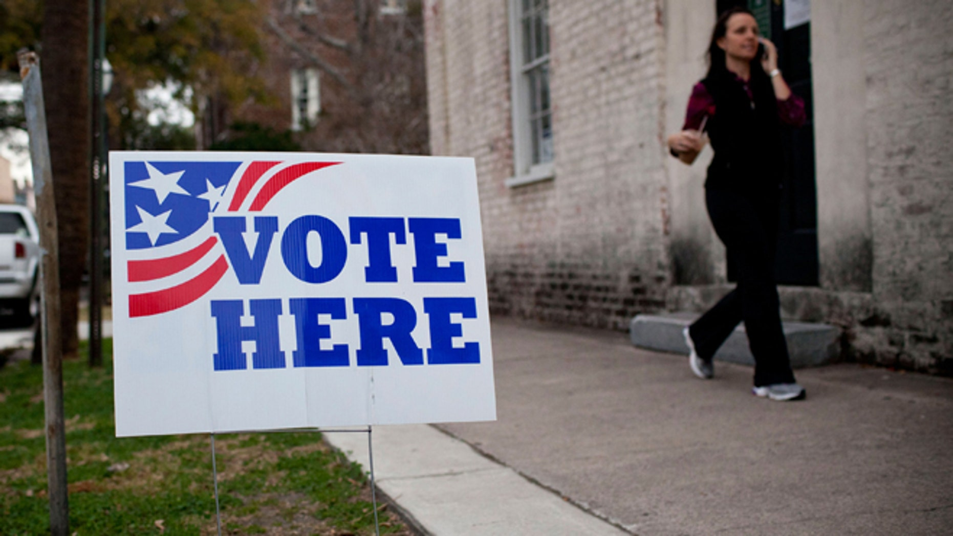 """CHARLESTON, SC - JANUARY 21:  A """"Vote Here"""" sign is seen outside an East Bay Street voting station on January 21, 2012 in Charleston, South Carolina. Voters decided between four major candidates in the key conservative state.  (Photo by Andrew Burton/Getty Images)"""