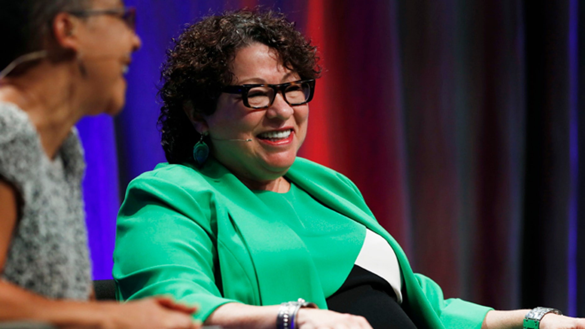 Supreme Court Justice Sonia Sotomayor jokes with Lauren Casteel during an appearance on the campus of Metropolitan State University, Thursday, Sept. 1, 2016, in Denver. (AP Photo/David Zalubowski)