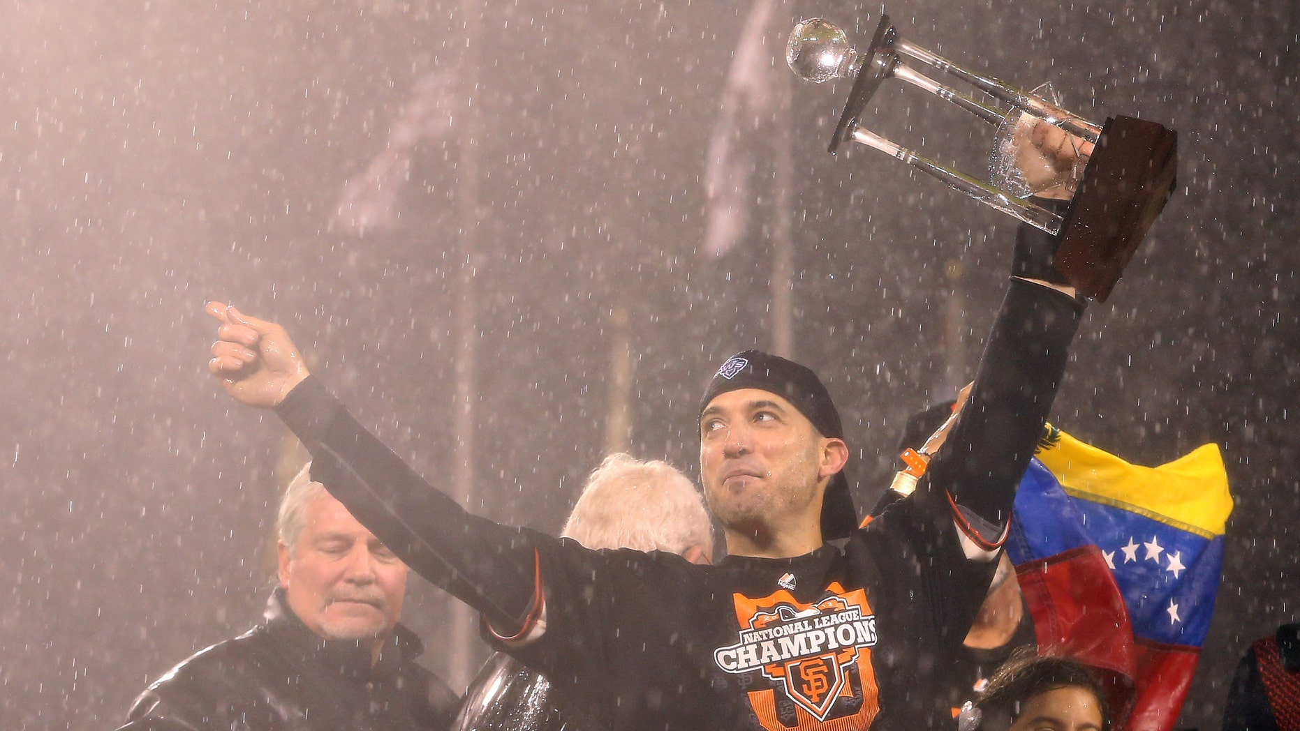 SAN FRANCISCO, CA - OCTOBER 22:  Marco Scutaro #19 of the San Francisco Giants holds up the MVP trophy after the Giants defeat the St. Louis Cardinals 9-0 in Game Seven of the National League Championship Series at AT&T Park on October 22, 2012 in San Francisco, California.  (Photo by Christian Petersen/Getty Images)