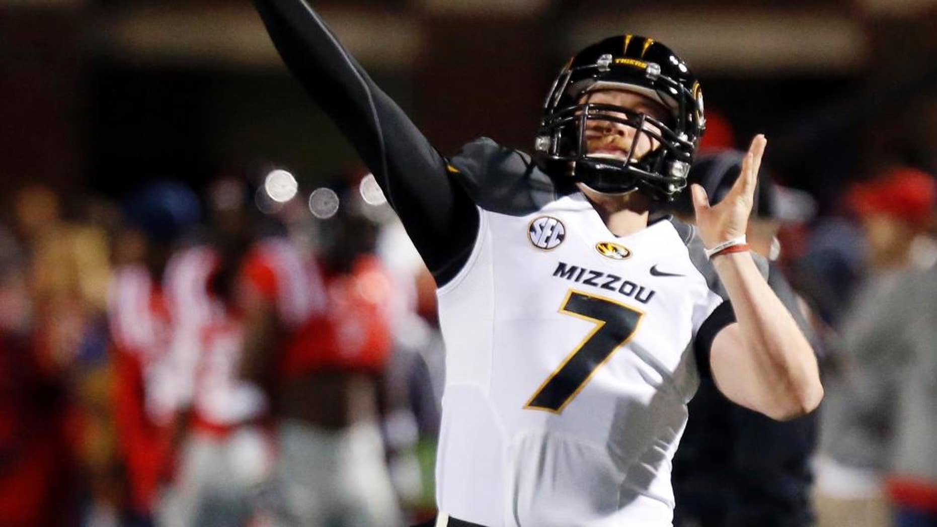FILE - In this Nov. 23, 2013, file photo, Missouri quarterback Maty Mauk (7) throws downfield to a receiver during pregame drills before their NCAA college football game against Mississippi, in Oxford, Miss. Mauk is one of the SEC's new starting quarterbacks.  (AP Photo/Rogelio V. Solis, File)