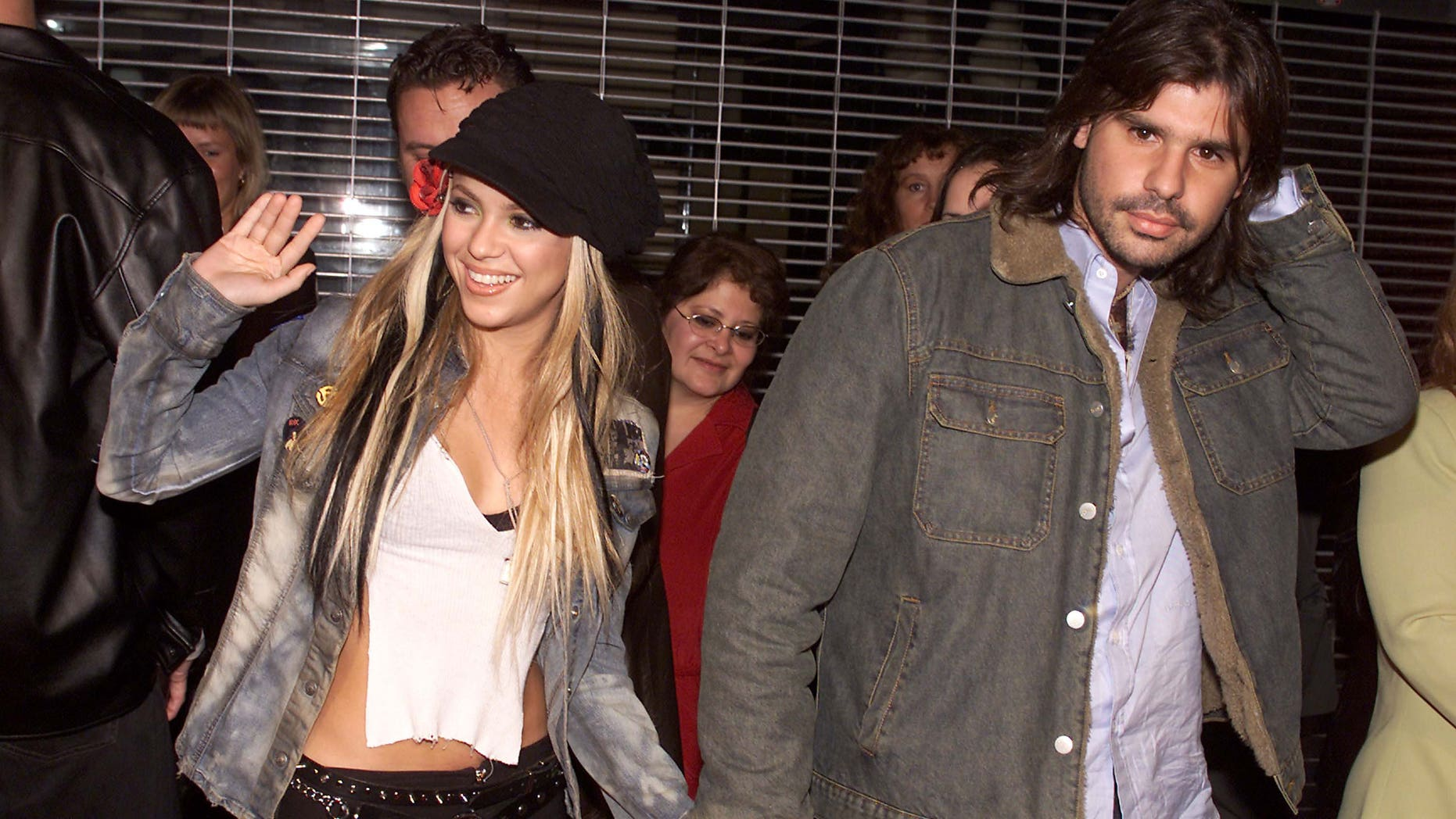 """Shakira and boyfriend Antonio de la Rua at the El Rey Theater in Los Angeles to help Mick Jagger celebrate the release of his new solo album """"Goddess in the Doorway"""" with a live performance. Thursday, November 15, 2001. Photo by Kevin Winter/Getty Images."""