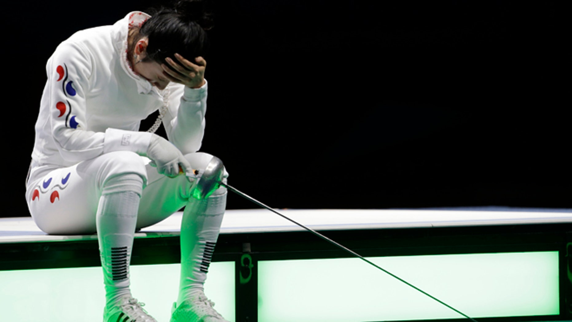 July 30, 2012: South Korea's Shin A-lam waits for an appeal to an officials decision after a women's individual epee fencing semifinals match against Germany's Britta Heidemann at the 2012 Summer Olympics, in London.