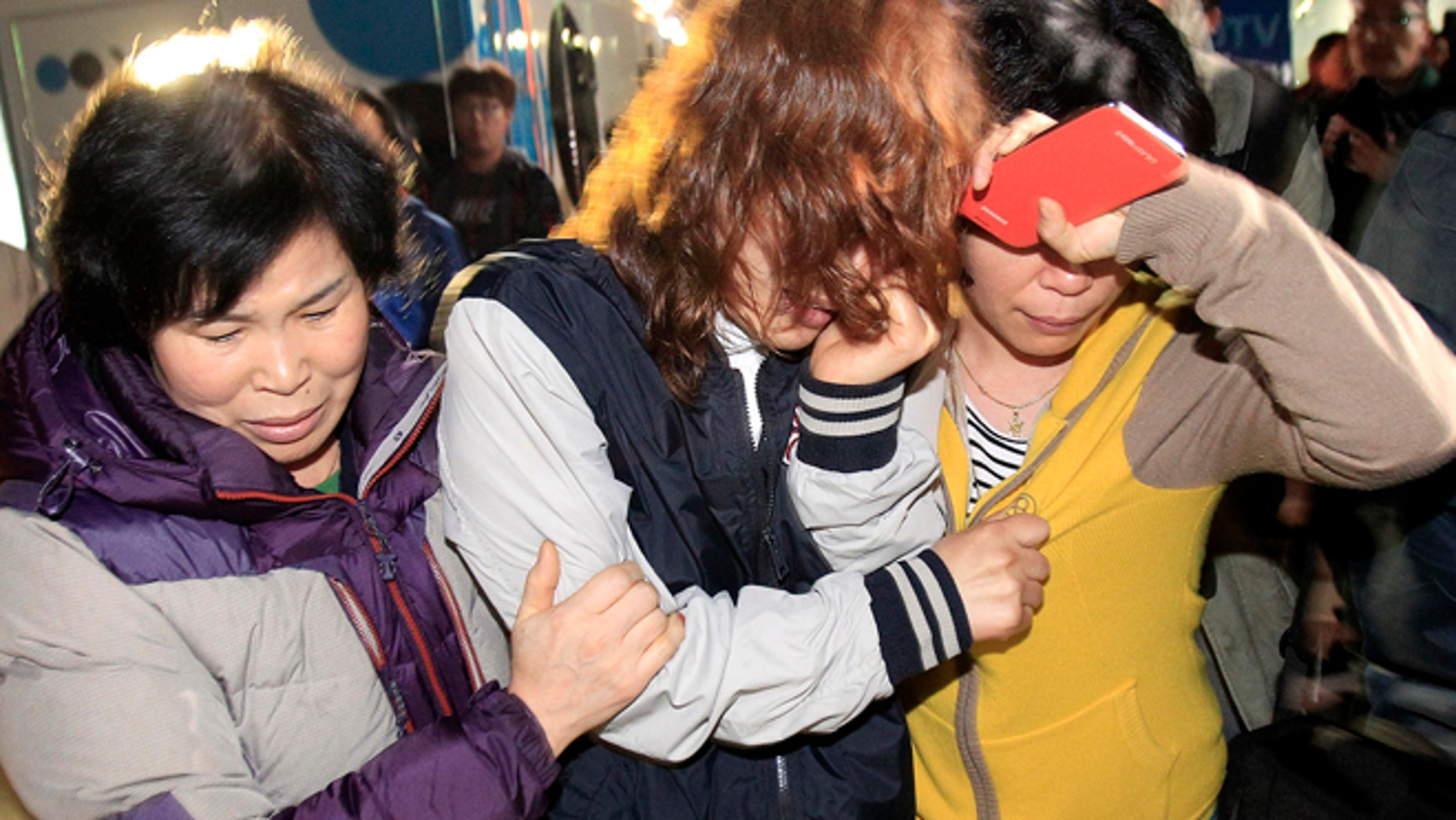 April 16: Relatives arrive to wait for missing people at a port in Jindo,South Korea.