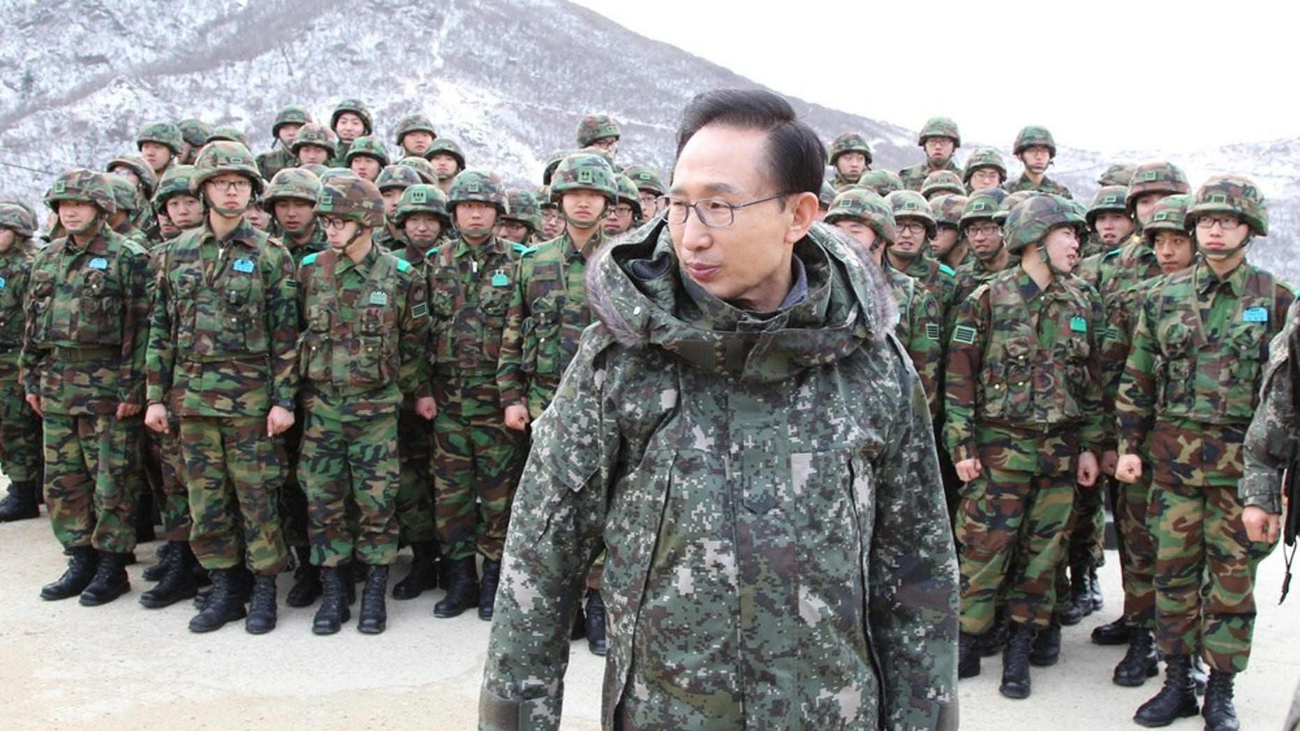 Dec. 23, 2010: South Korean President Lee Myung-bak leaves after taking photographs with soldiers during his visit to a military observation post of the front-line unit in the demilitarized zone in Yanggu, far northeast of Seoul.