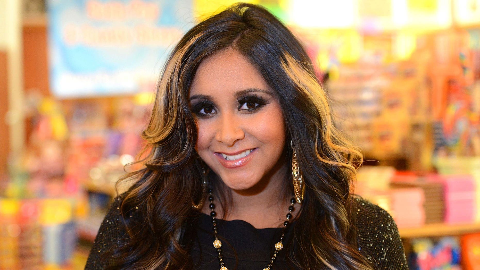 """LOS ANGELES, CA - JULY 18:  Reality TV star Nicole """"Snooki"""" Polizzi launches Snooki's Wild Cherry soda held at Rocket Fizz Soda Pop and Candy Shop on July 18, 2012 in Los Angeles, California.  (Photo by Jason Merritt/Getty Images)"""