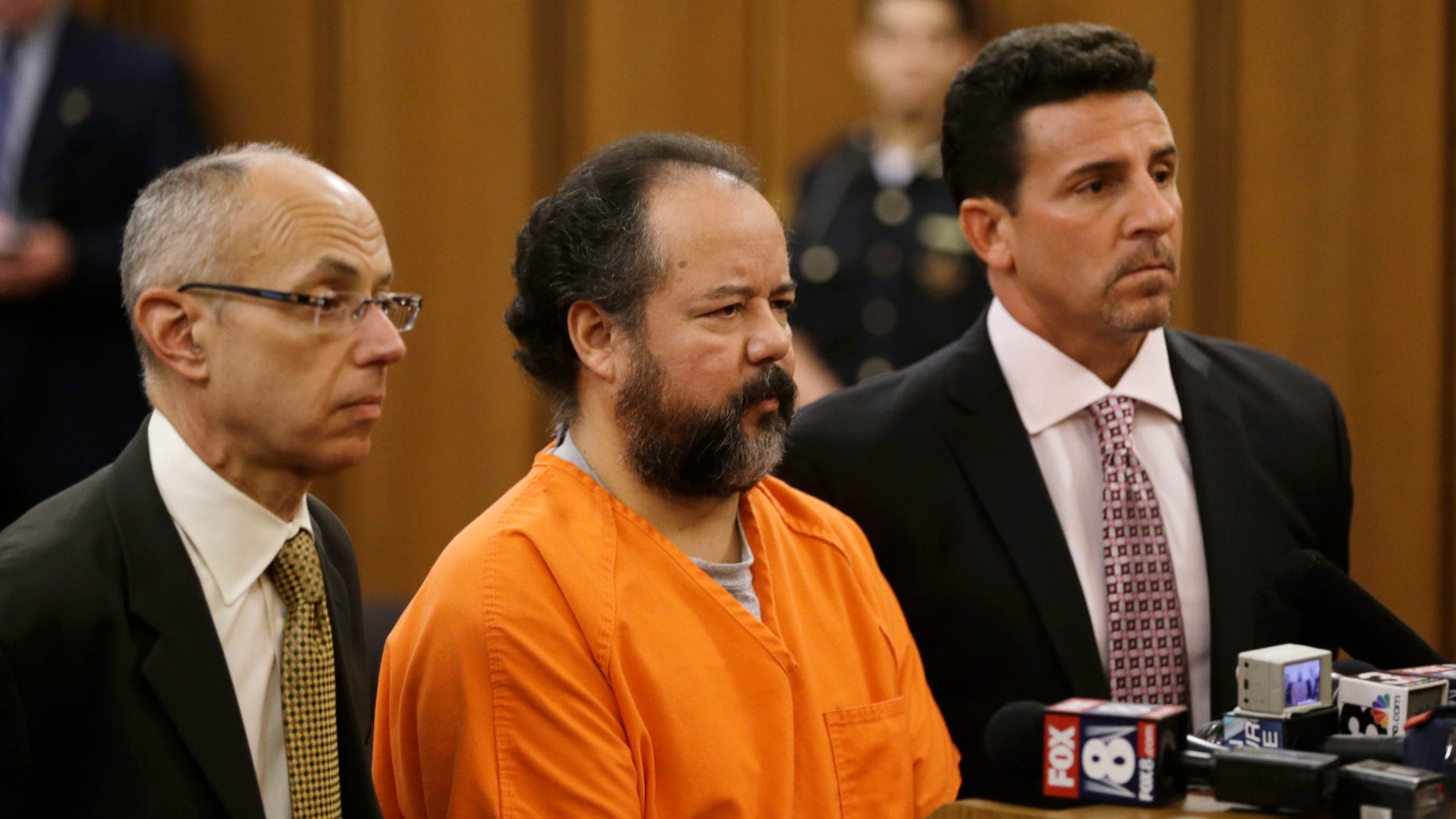 Ariel Castro with his defense attorneys during his arraignment Wednesday, July 17, 2013, in Cleveland.