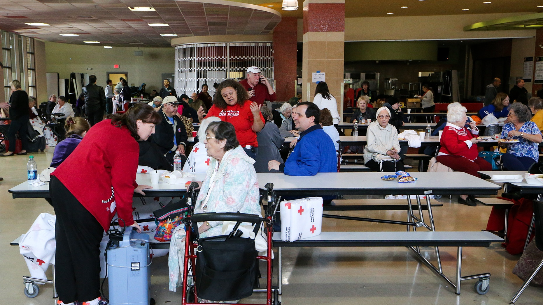 Dec. 28, 2014 - Seniors in a cafeteria at the Churchill School, a  makeshift shelter  after a fire at the senior-living Wedgwood Apartments in Castle Hills, a suburb of San Antonio Texas. 17 remained hospitalized and 5 residents were killed in the blaze.