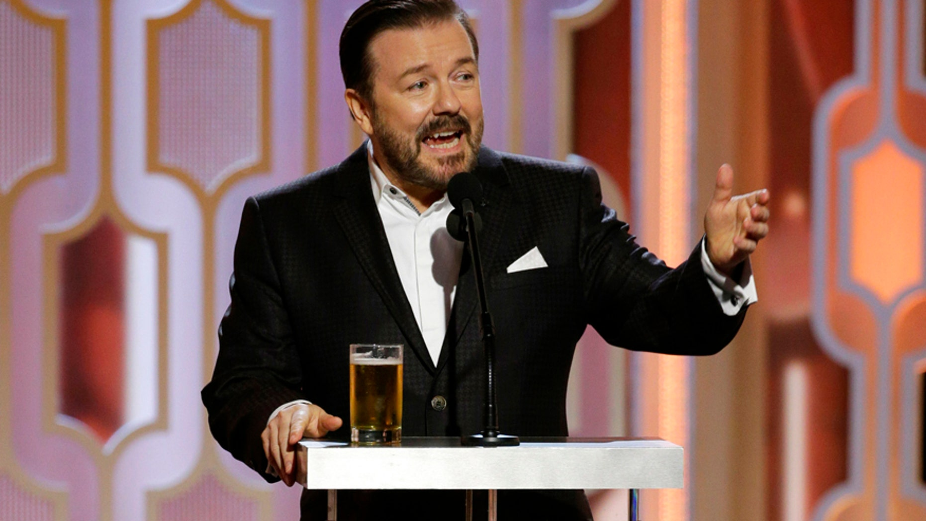 In this image released by NBC, host Ricky Gervais appears at the 73rd Annual Golden Globe Awards at the Beverly Hilton Hotel in Beverly Hills, Calif., on Sunday, Jan. 10, 2016.