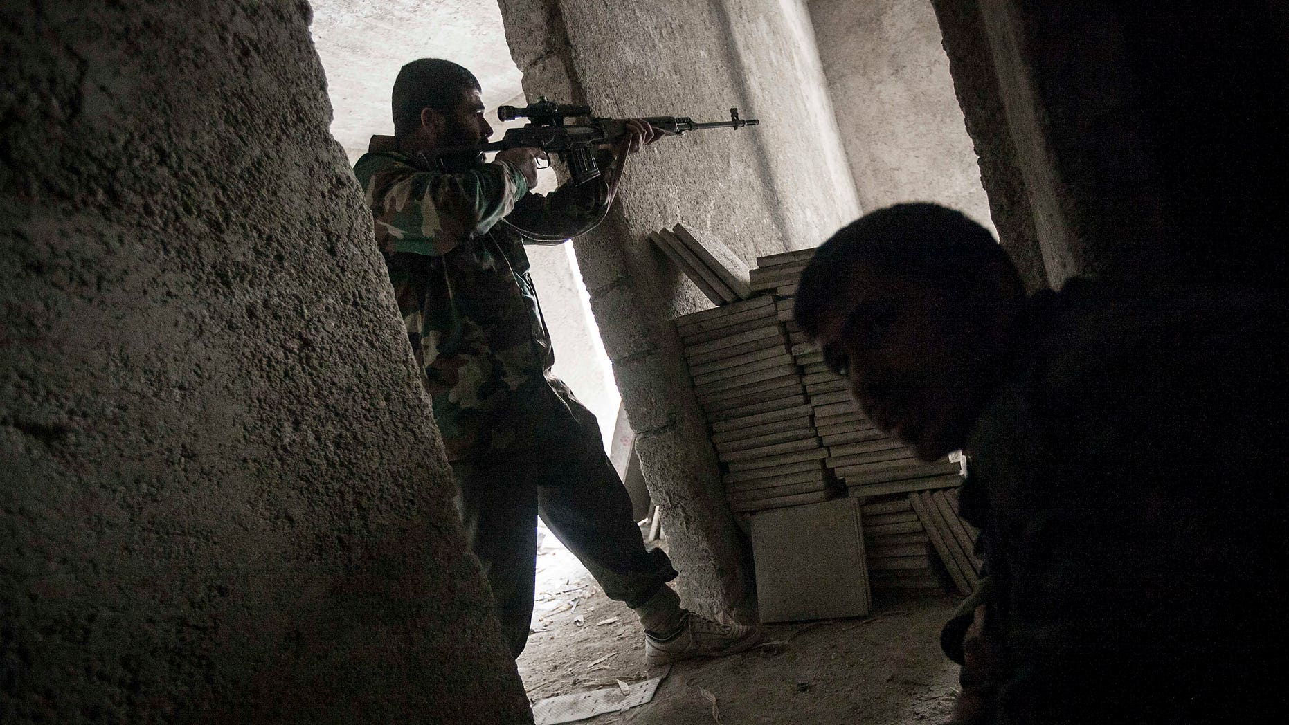 Dec 7, 2012 - Rebel fighter in Aleppo, Syria.