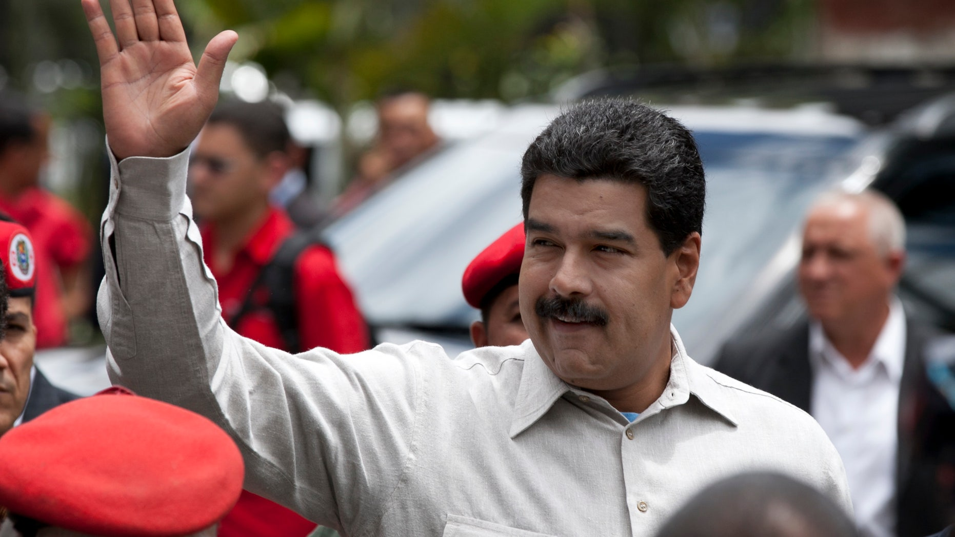 Nicolás Maduro waves during a visit to the Bolivarian National Guard command in Caracas, Venezuela, on Oct. 2, 2013.