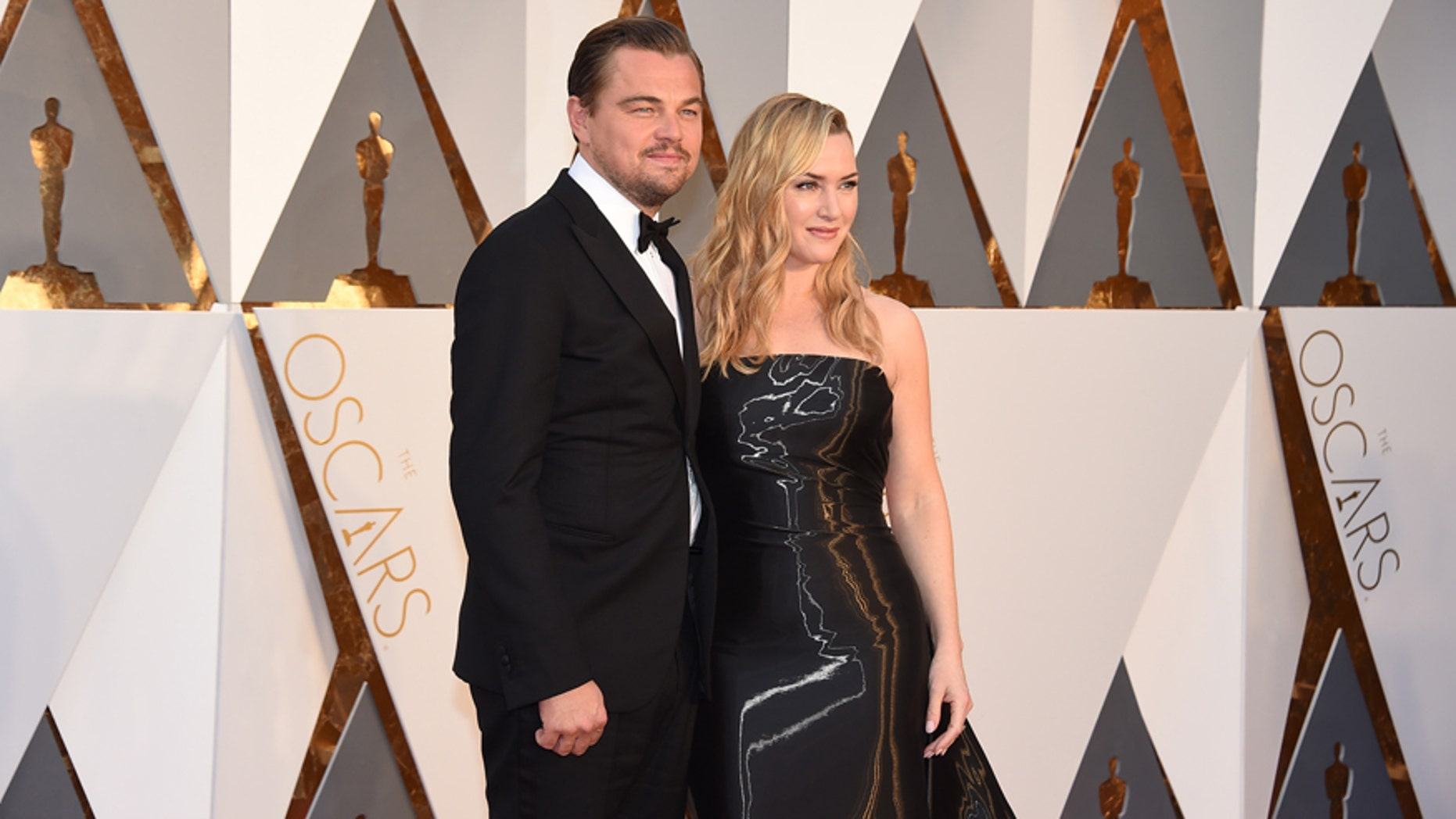 Leonardo DiCaprio, left, and Kate Winslet arrive at the Oscars on Sunday, Feb. 28, 2016, at the Dolby Theatre in Los Angeles.