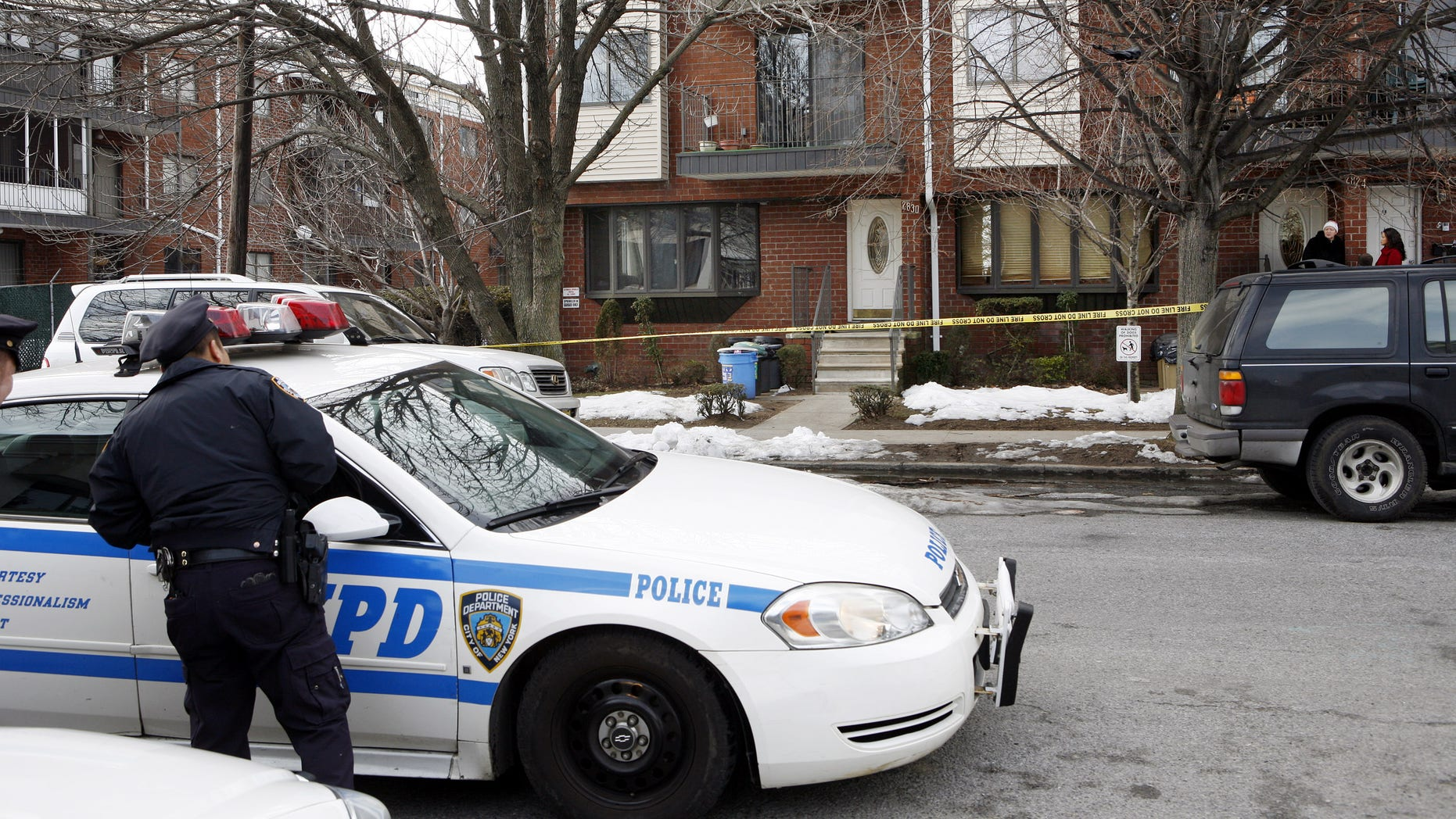 Feb. 12: Police stand outside the house in the Brooklyn borough of New York where Maksim Gelman lived and where police say he killed his stepfather on Friday morning.  The 23-year-old Brooklyn man was in custody Saturday after a 28-hour stabbing rampage that took the lives of his stepfather, his ex-girlfriend and her mother, and led to a nightlong manhunt across New York City, police said. Authorities said Gelman also hijacked a car, stabbing and wounding the driver and fatally hitting a pedestrian. (AP)