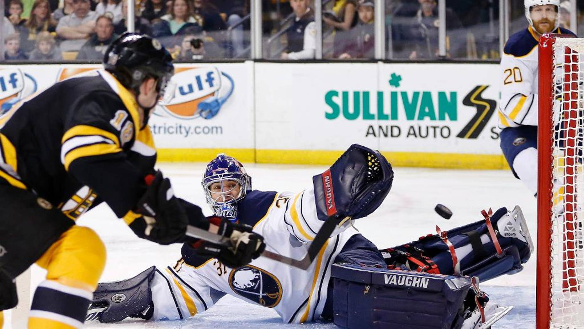 Boston Bruins' Reilly Smith (18) shoots wide of Buffalo Sabres' Matt Hackett (31) during the second period of an NHL hockey game in Boston, Saturday, April 12, 2014. (AP Photo/Michael Dwyer)