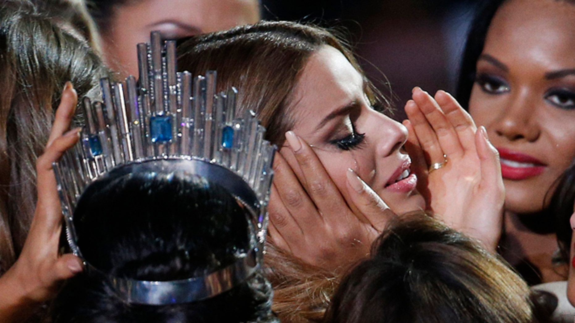 Contestants comfort Miss Colombia Ariadna Gutierrez after she was incorrectly crowned Miss Universe on Dec. 20, 2015.