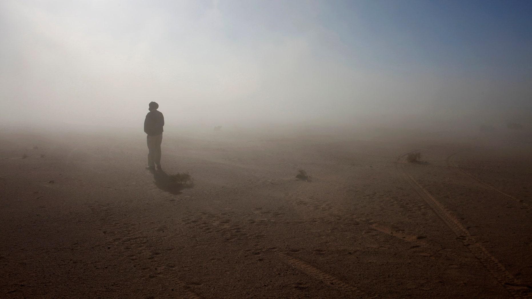 File photo - A Sahrawi man stands in the Sahara desert between Tindouf and Tifariti,