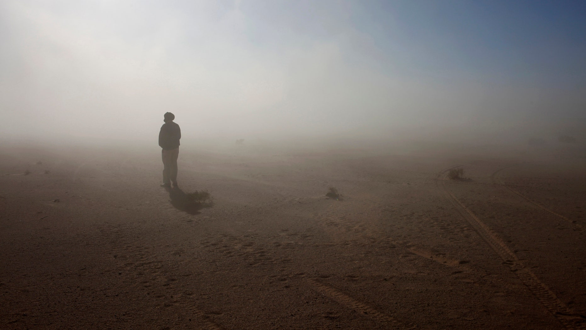 File photo - A Sahrawi man stands in the Sahara desert between Tindouf and Tifariti,