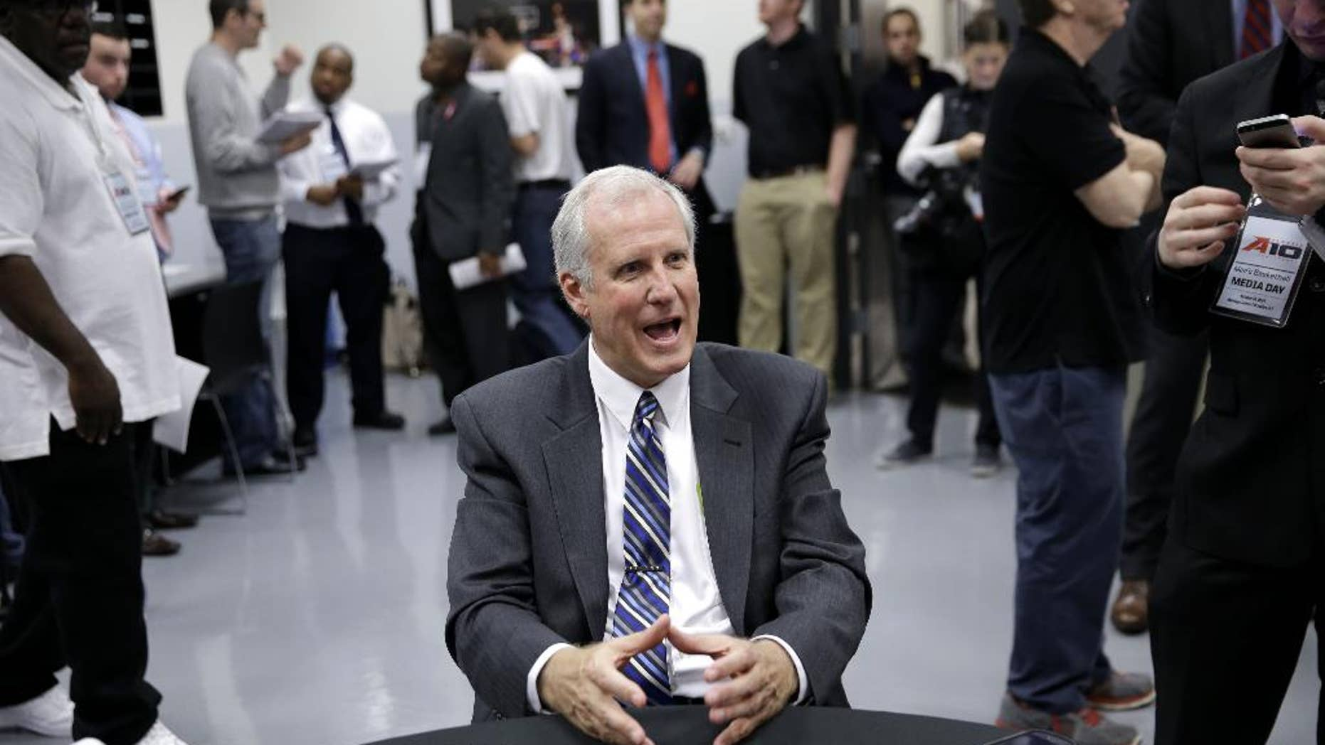 FILE - In this Oct. 14, 2014, file photo, Saint Louis men's NCAA college basketball head coach Jim Crews talks to reporters during the Atlantic 10 media day in New York. Saint Louis has been to the NCAA tournament a school-record three straight seasons, but a fourth will be tough with five new starters. (AP Photo/Seth Wenig, File)