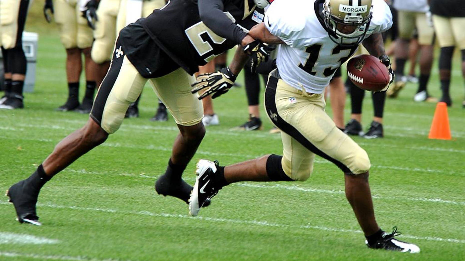 New Orleans Saints' Jairus Byrd (31) catches a pass during NFL football training camp in White Sulphur Springs, W. Va., Friday, July 25, 2014. (AP Photo/Chris Tilley)