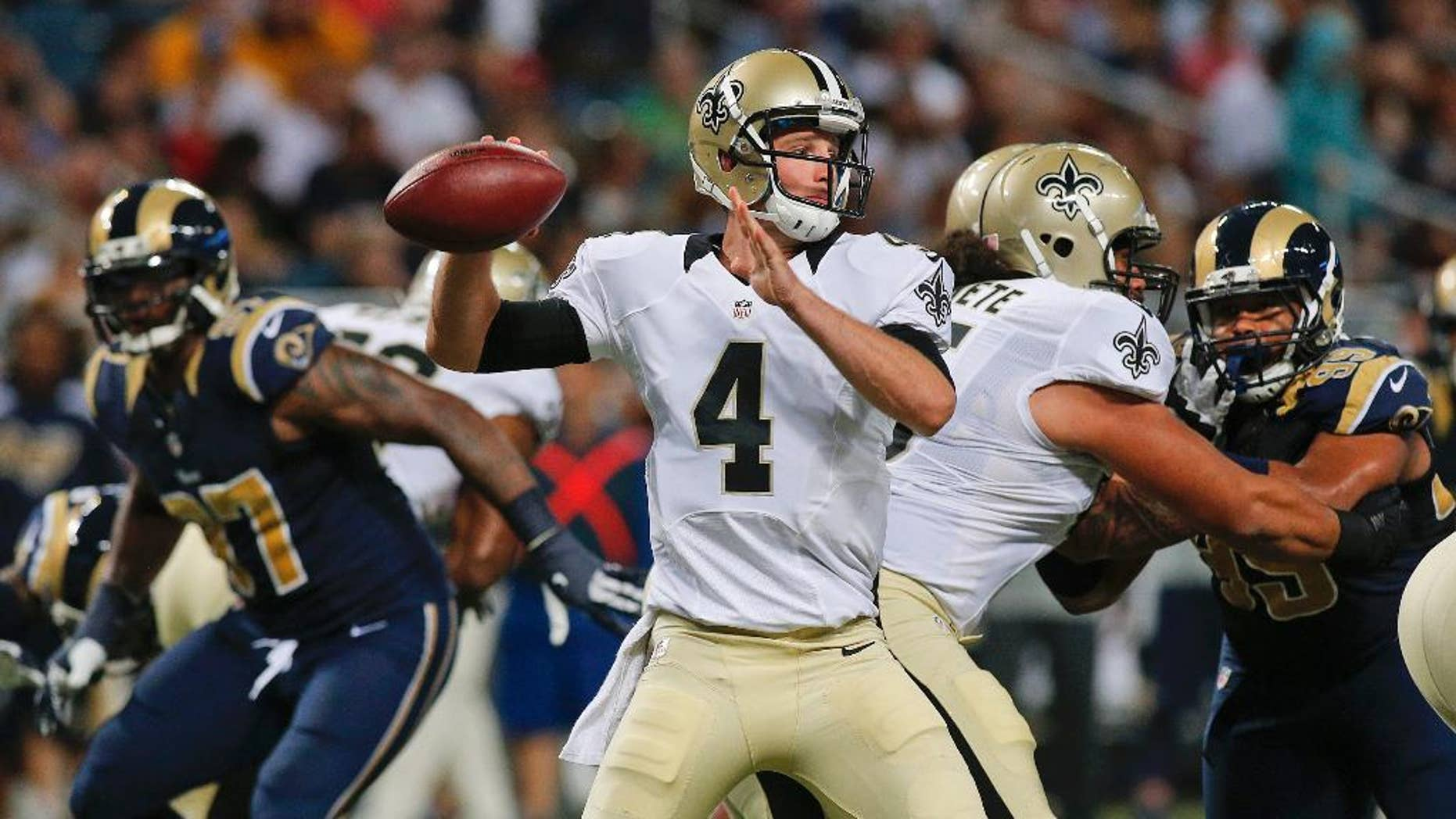 New Orleans Saints quarterback Ryan Griffin (4) passes against the St. Louis Rams during the first quarter of a preseason NFL football game Friday, Aug. 8, 2014, in St. Louis. (AP Photo/Scott Kane)