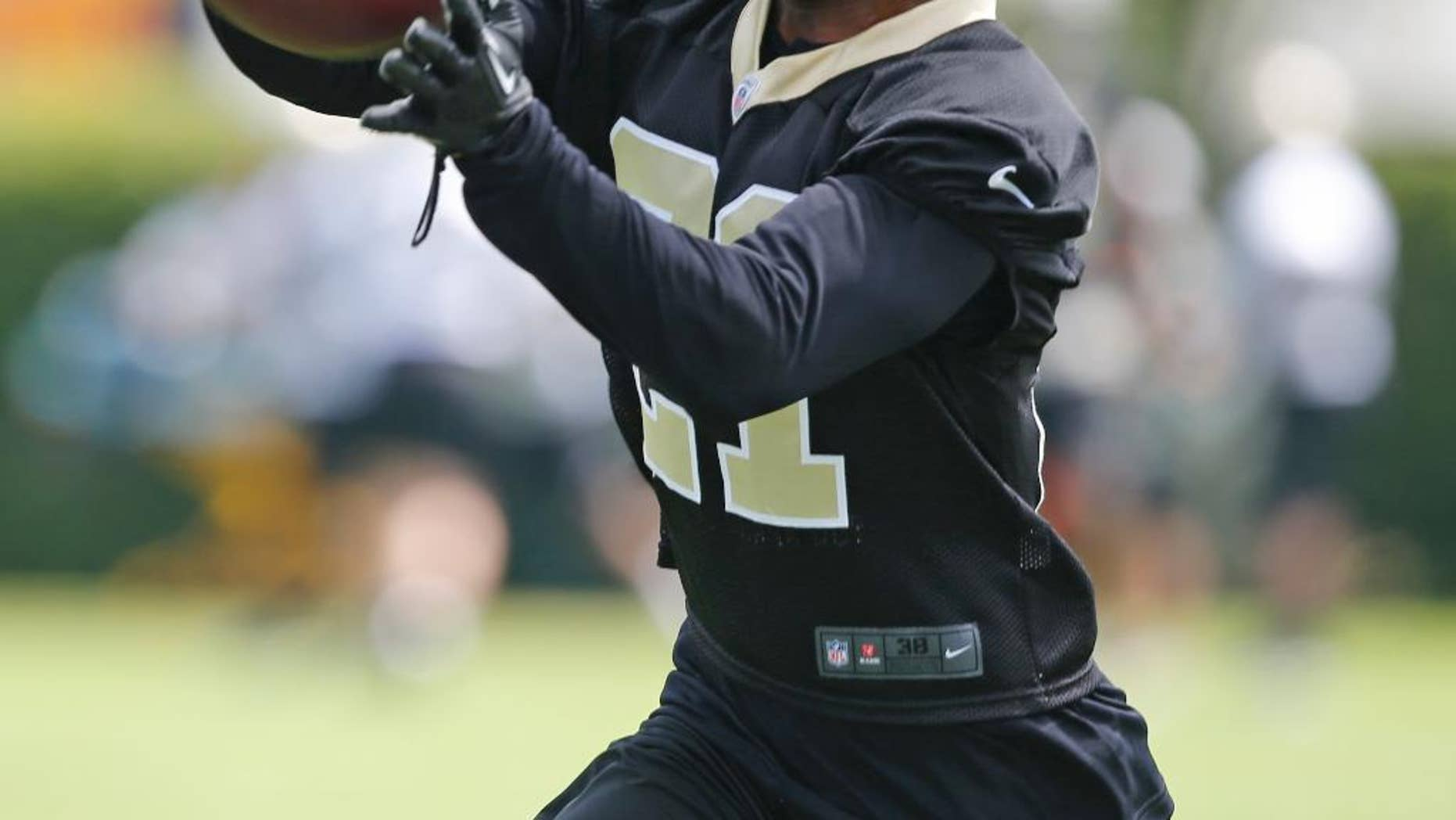 """FILE - New Orleans Saints cornerback Patrick Robinson (21) during an NFL football minicamp in Metairie, La., in this May 29, 2014 file photo. Saints cornerback Patrick Robinson is back in the starting role he was drafted to play, and looking a lot more comfortable this time.  """"My confidence is a lot better than it was the last couple years,"""" Robinson said after Thursday's practice Dec. 4, 2014. """"I think that makes a huge difference."""" (AP Photo/Bill Haber, File)"""