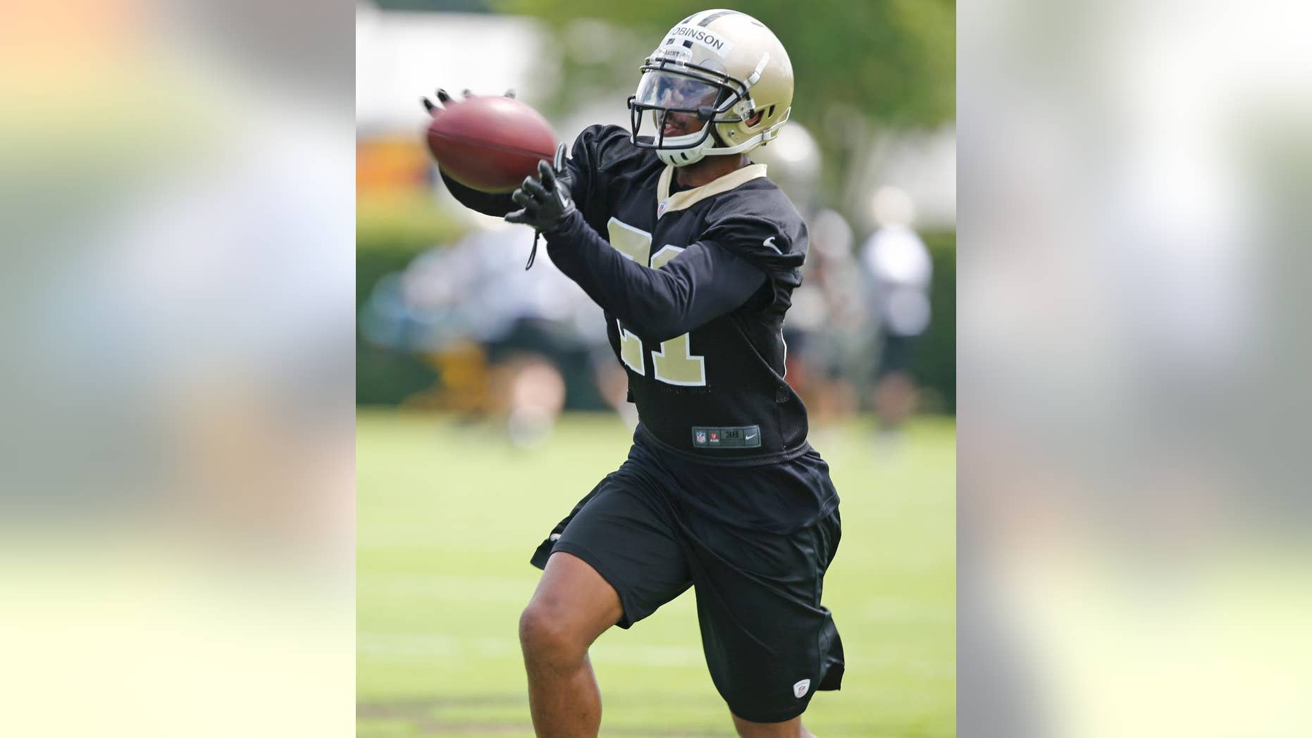 "FILE - New Orleans Saints cornerback Patrick Robinson (21) during an NFL football minicamp in Metairie, La., in this May 29, 2014 file photo. Saints cornerback Patrick Robinson is back in the starting role he was drafted to play, and looking a lot more comfortable this time.  ""My confidence is a lot better than it was the last couple years,"" Robinson said after Thursday's practice Dec. 4, 2014. ""I think that makes a huge difference."" (AP Photo/Bill Haber, File)"