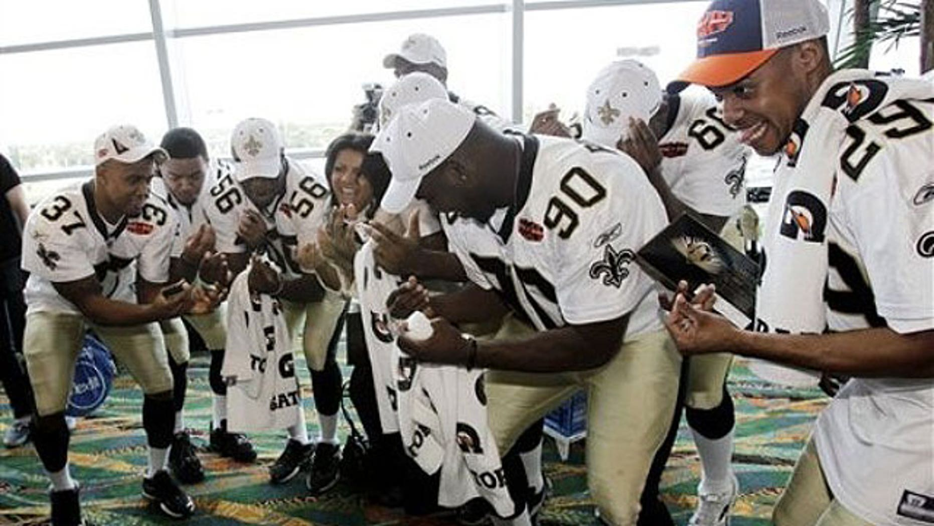 Some of the New Orleans Saints get down at a Super Bowl press conference. (AP)