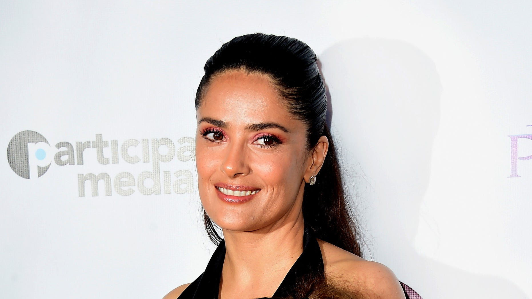 """LOS ANGELES, CA - JULY 29:  Actress Salma Hayek and daughter Valentina Paloma Pinault arrive at the Screening of GKIDS' """"Kahlil Gibran's The Prophet"""" at Bing Theatre At LACMA on July 29, 2015 in Los Angeles, California.  (Photo by Frazer Harrison/Getty Images)"""