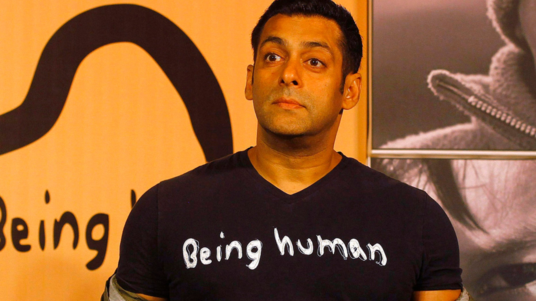 In this Jan. 17, 2013 file photo, Bollywood star Salman Khan poses wearing a Being Human t-shirt during the launch of Being Human's first flagship store in Mumbai, India.