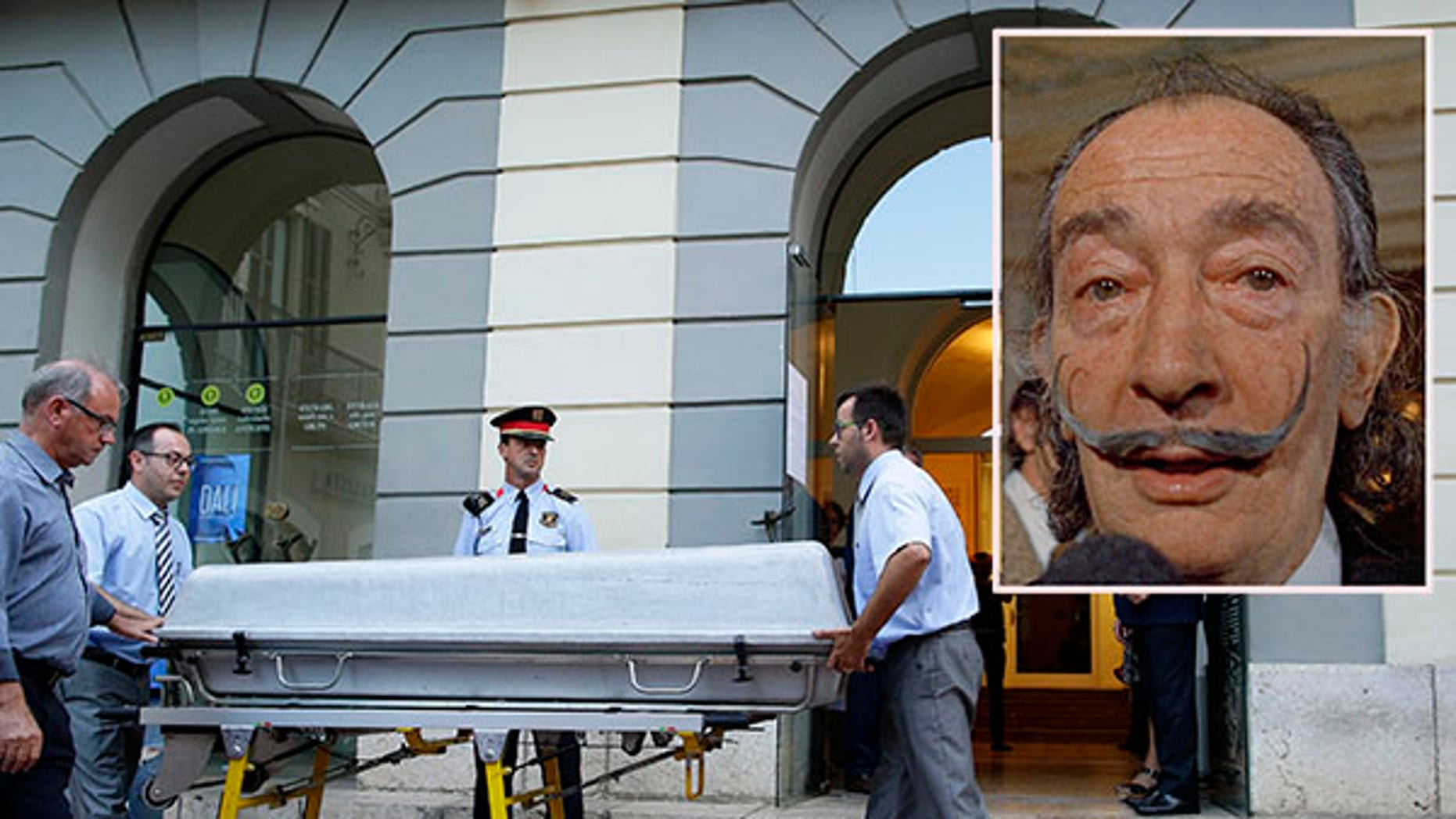 Workers bring a casket to the Dali Theater Museum in Spain.