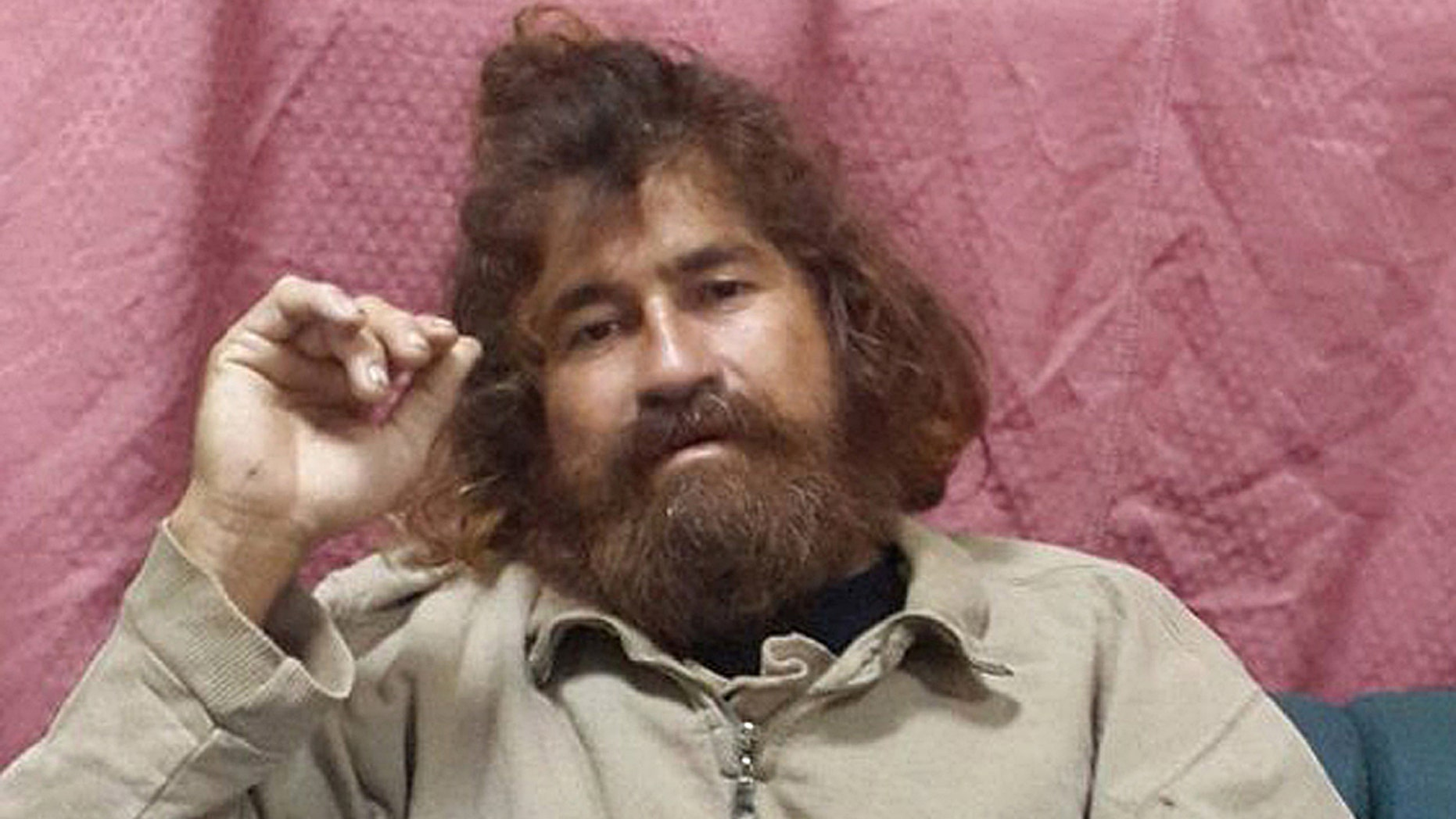 Jose Salvador Alvarenga sits on a couch in Majuro in the Marshall Islands, after he was rescued from being washed ashore on the tiny atoll of Ebon in the Pacific Ocean.
