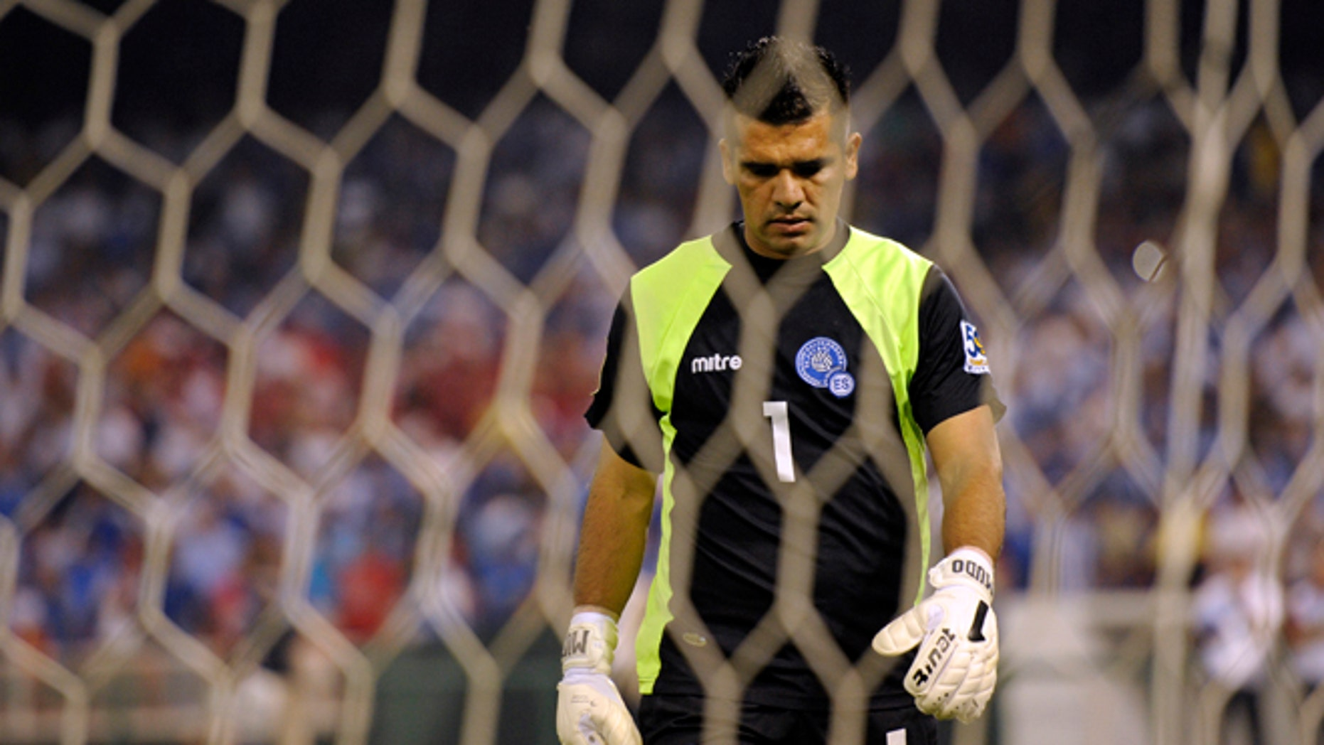 FILE - In this June 19, 2011 file photo, El Salvador goalkeeper Miguel Montes lowers his head after failing to stop a shot during penalty kicks in a CONCACAF Gold Cup quarterfinal soccer match against Panama at RFK Stadium in Washington. El Salvador's football federation announced on Wednesday, Aug. 21, 2013 it has suspended 22 of their players, included Montes, in an investigation into alleged match-fixing in games by the national team from 2010 to 2012. (AP Photo/Cliff Owen, File)