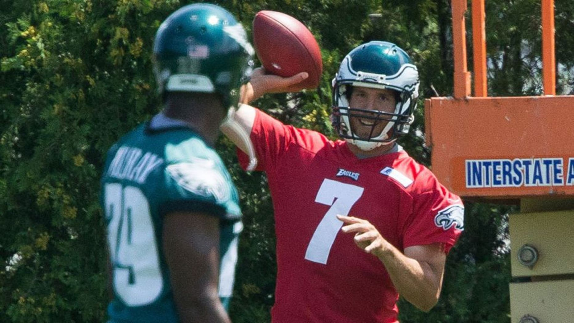 Aug 2, 2015; Philadelphia, PA, USA; Philadelphia Eagles quarterback Sam Bradford (7) throws to running back DeMarco Murray (29) during training camp at NovaCare Complex. Mandatory Credit: Bill Streicher-USA TODAY Sports