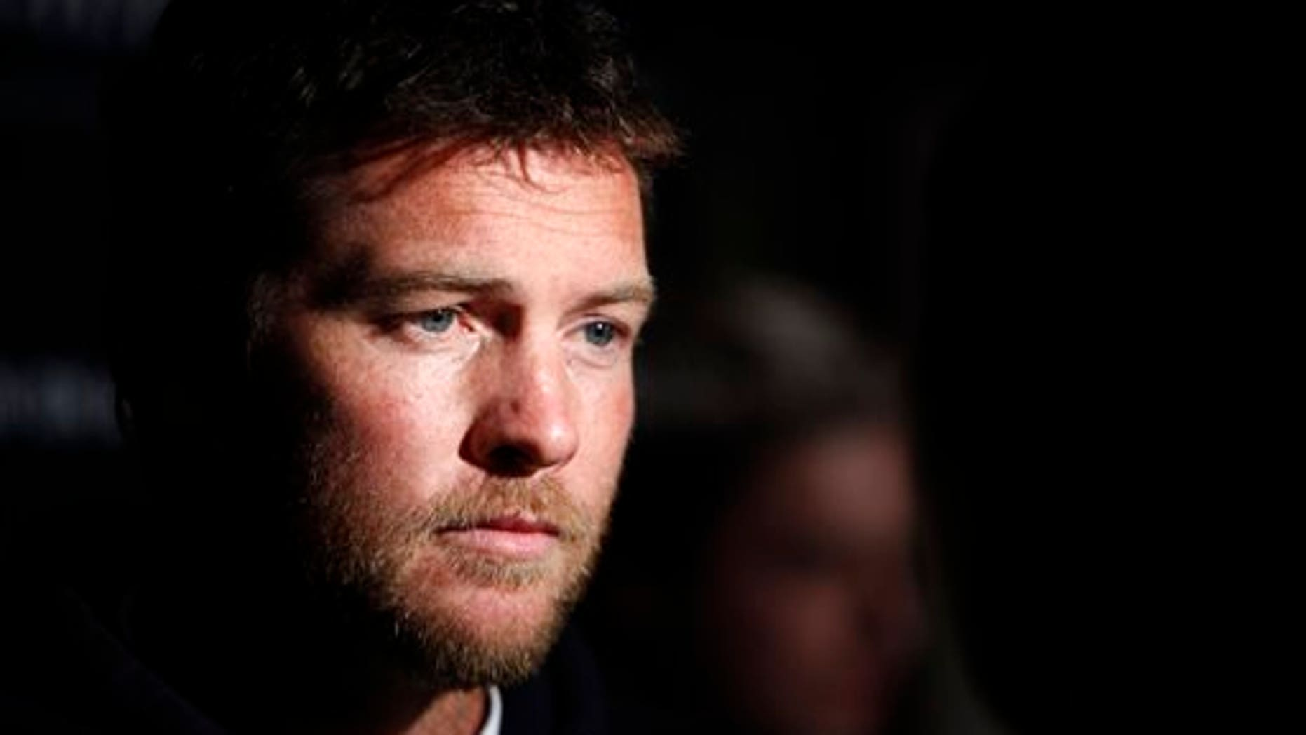 "FILE - In this Jan. 19, 2012 file photo, Actor Sam Worthington attends the Cinema Society premiere of ""Man on a Ledge"" in New York. Police say Worthington has been arrested Sunday, Feb. 23, 2014, in New York City for punching a photographer after the man kicked Worthington's girlfriend in the shin. The Australian actor was released on a desk appearance ticket and is due back in court on Feb. 26. (AP Photo/Peter Kramer, File)"