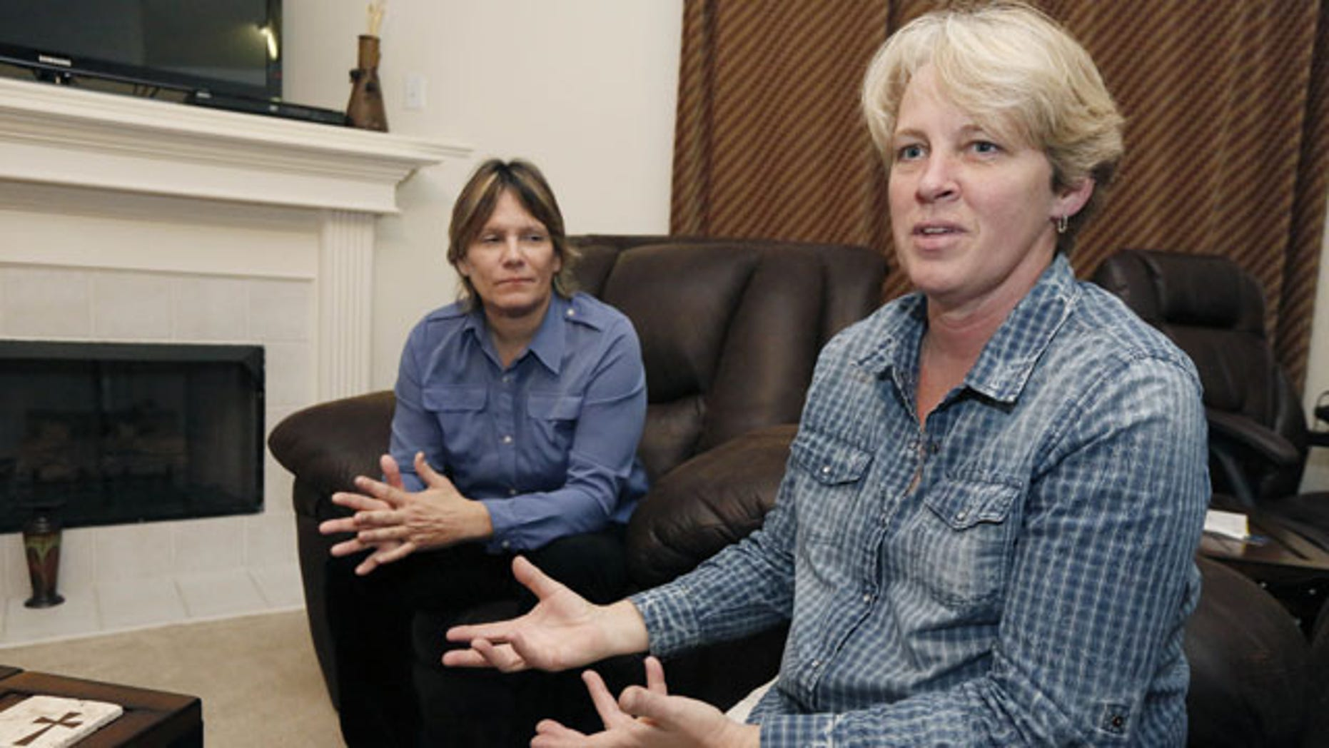 November 5, 2013: Dawn Jefferies, right, speaks in Hernando, Miss., about the efforts Lauren Czekala-Chatham, left, has taken to get the state to recognize a same sex marriage performed in California, so she can now divorce that same partner she lived with as a couple in DeSoto County, until they separated in 2010. Jefferies is Czekala-Chatham's new partner.