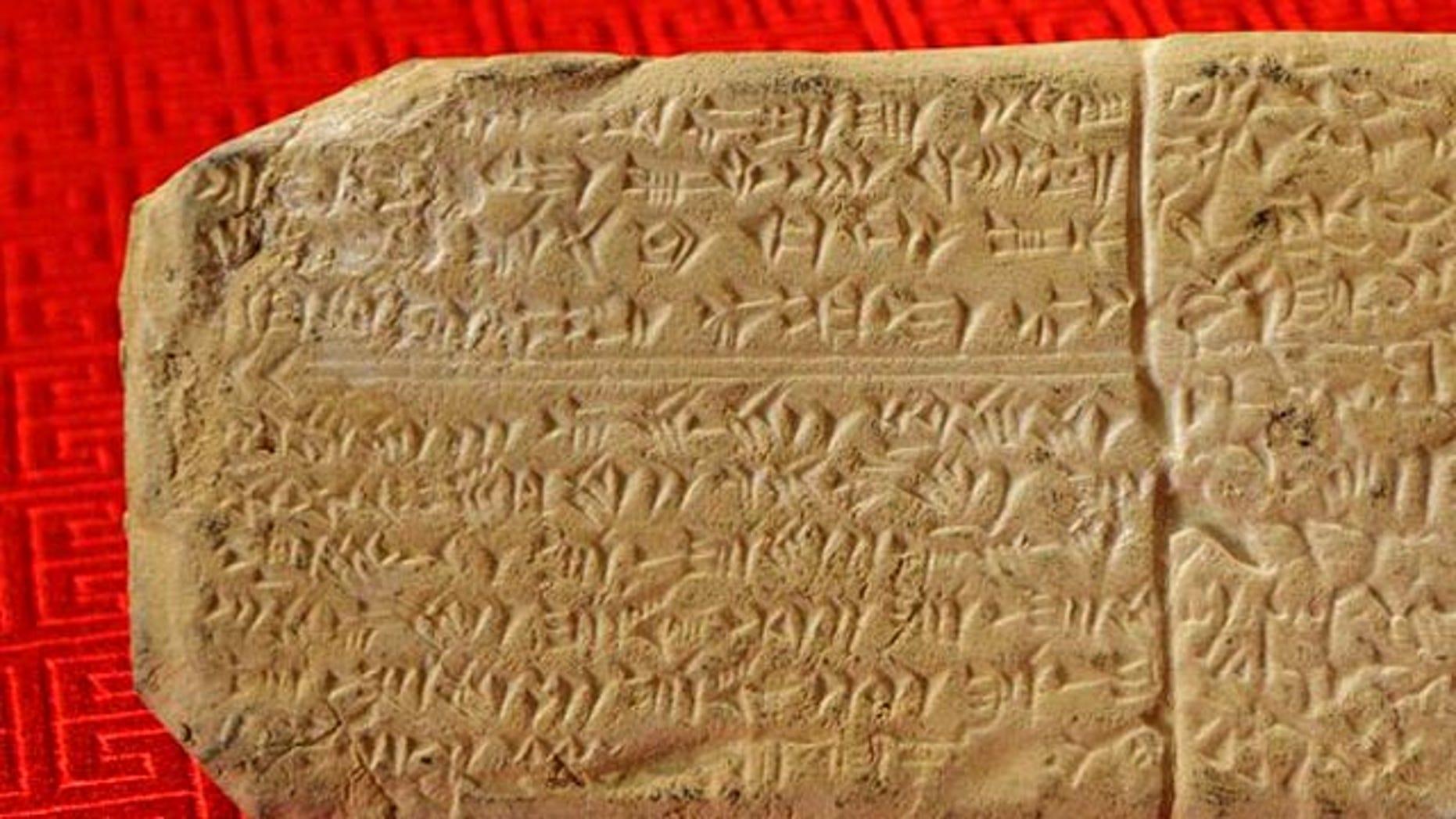 A sample of Ugaritic script on a gift-shop replica.